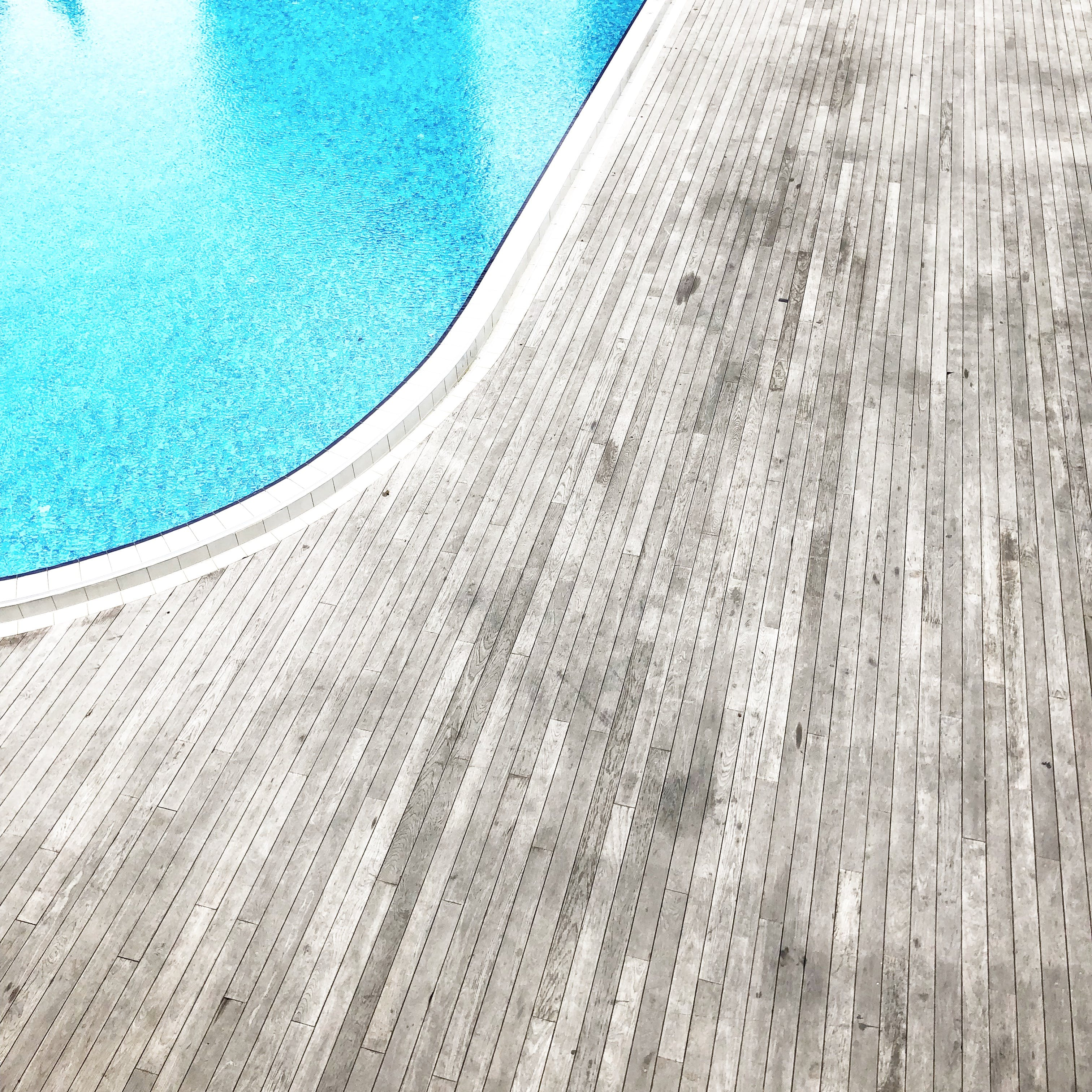 Wooden Floor Beside Pool