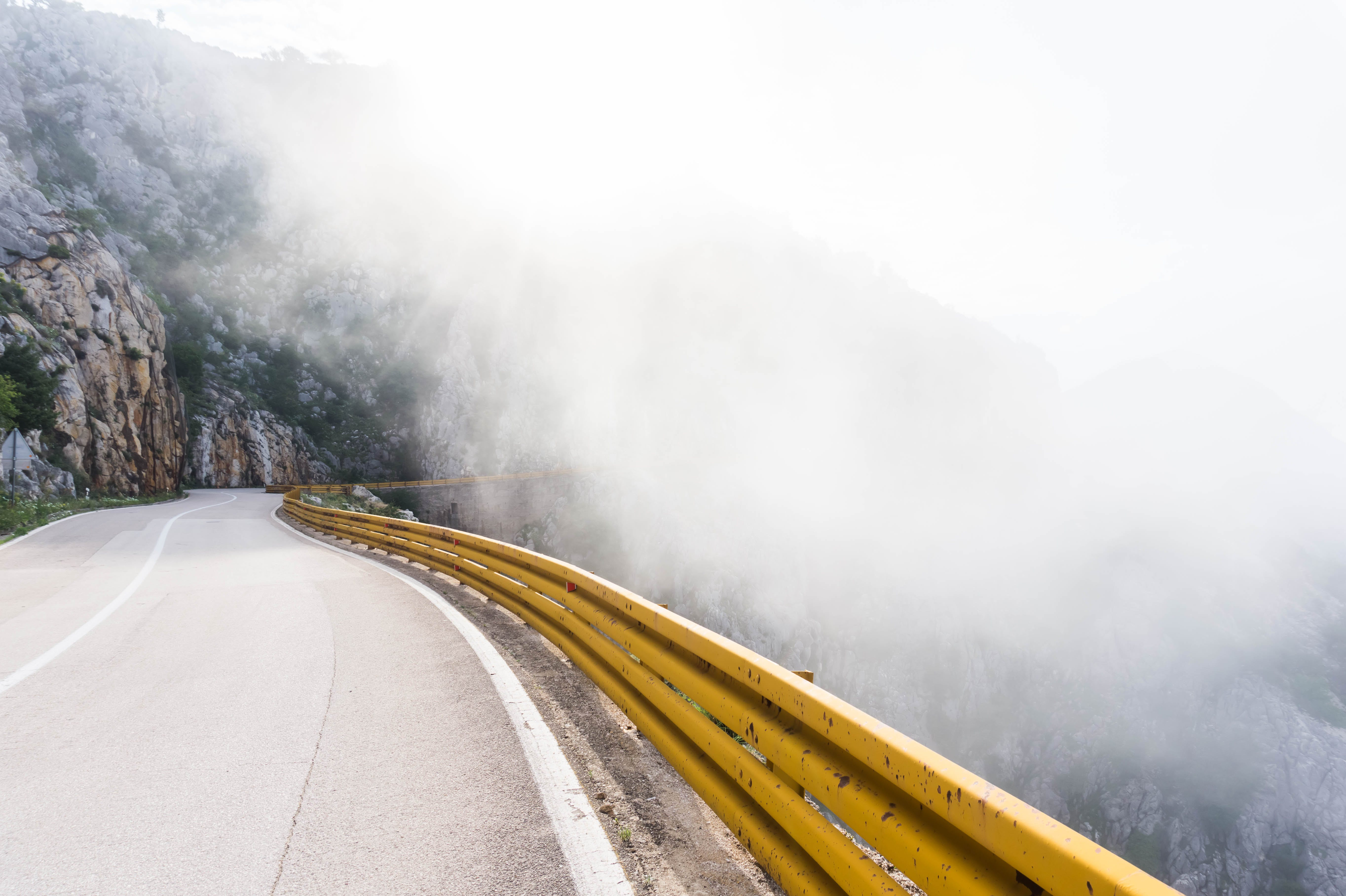 Photography of Highway with Near Fog