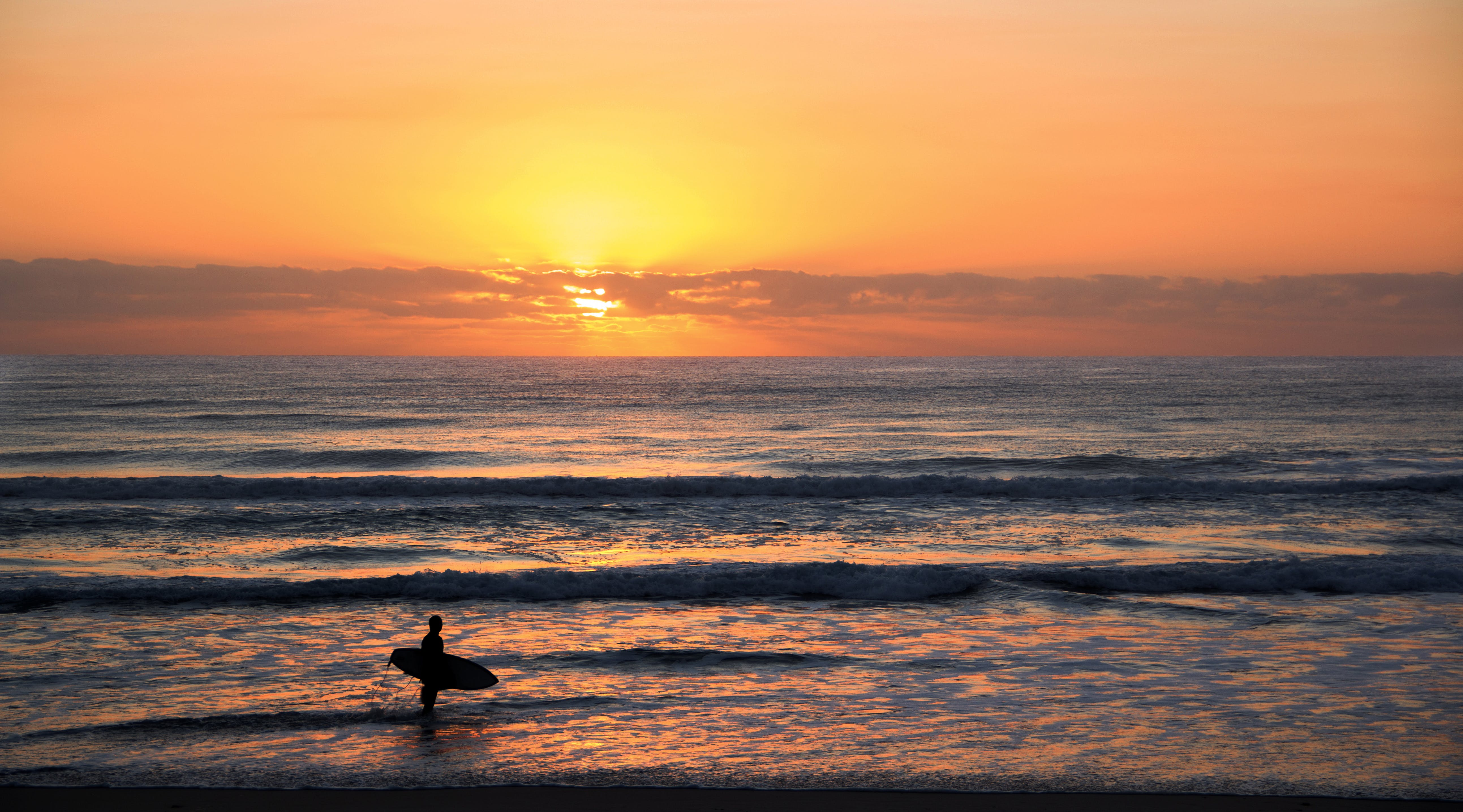 Photo of Surfer in Rule of Thirds Photography during Sunset