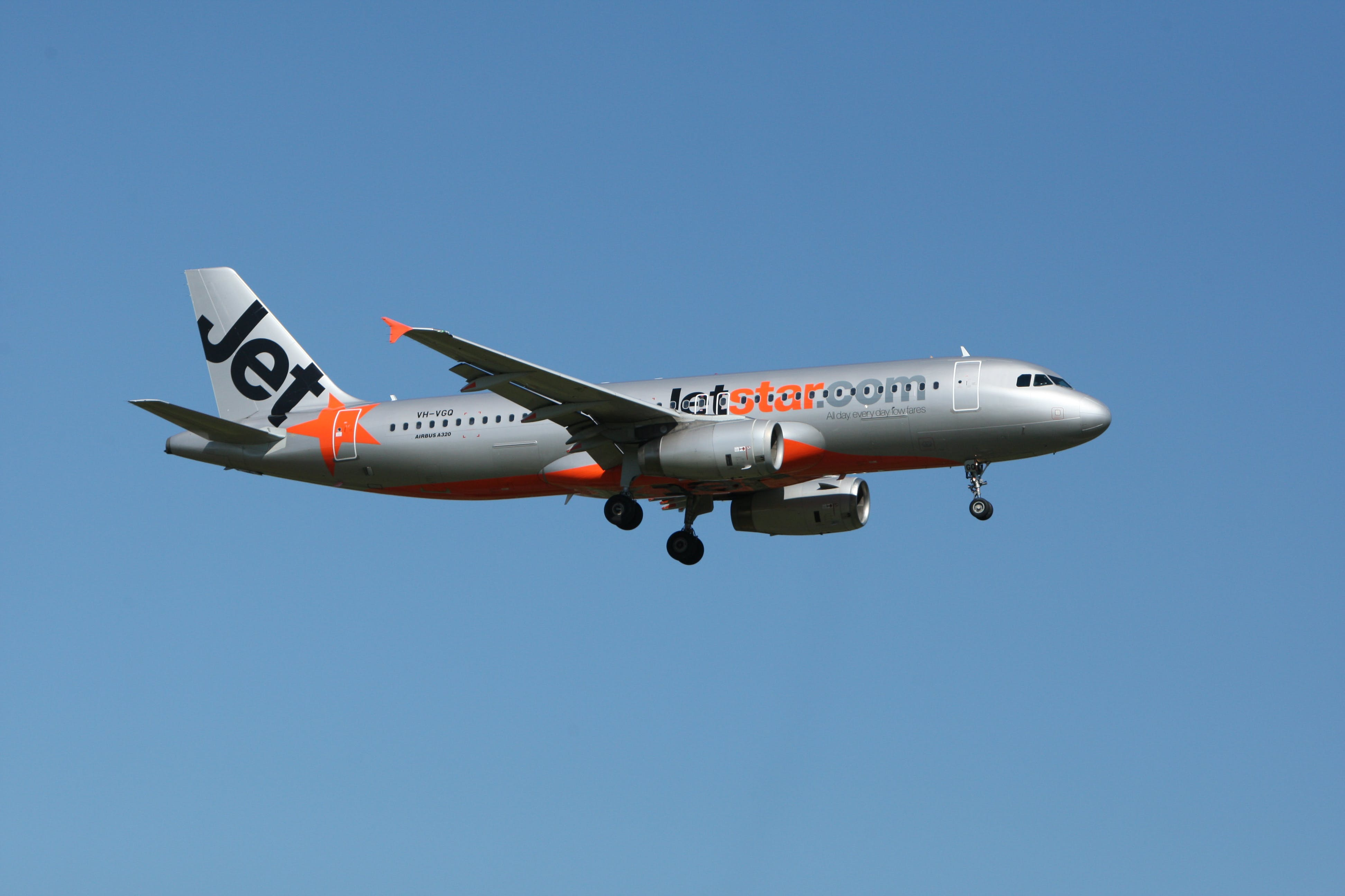 Jetstar Plane Flight Under Blue Sky