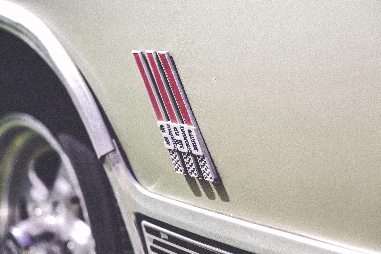 Close-Up Photography of Car Emblem