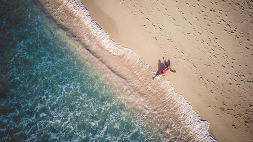 Person On Seashore Aerial Shot