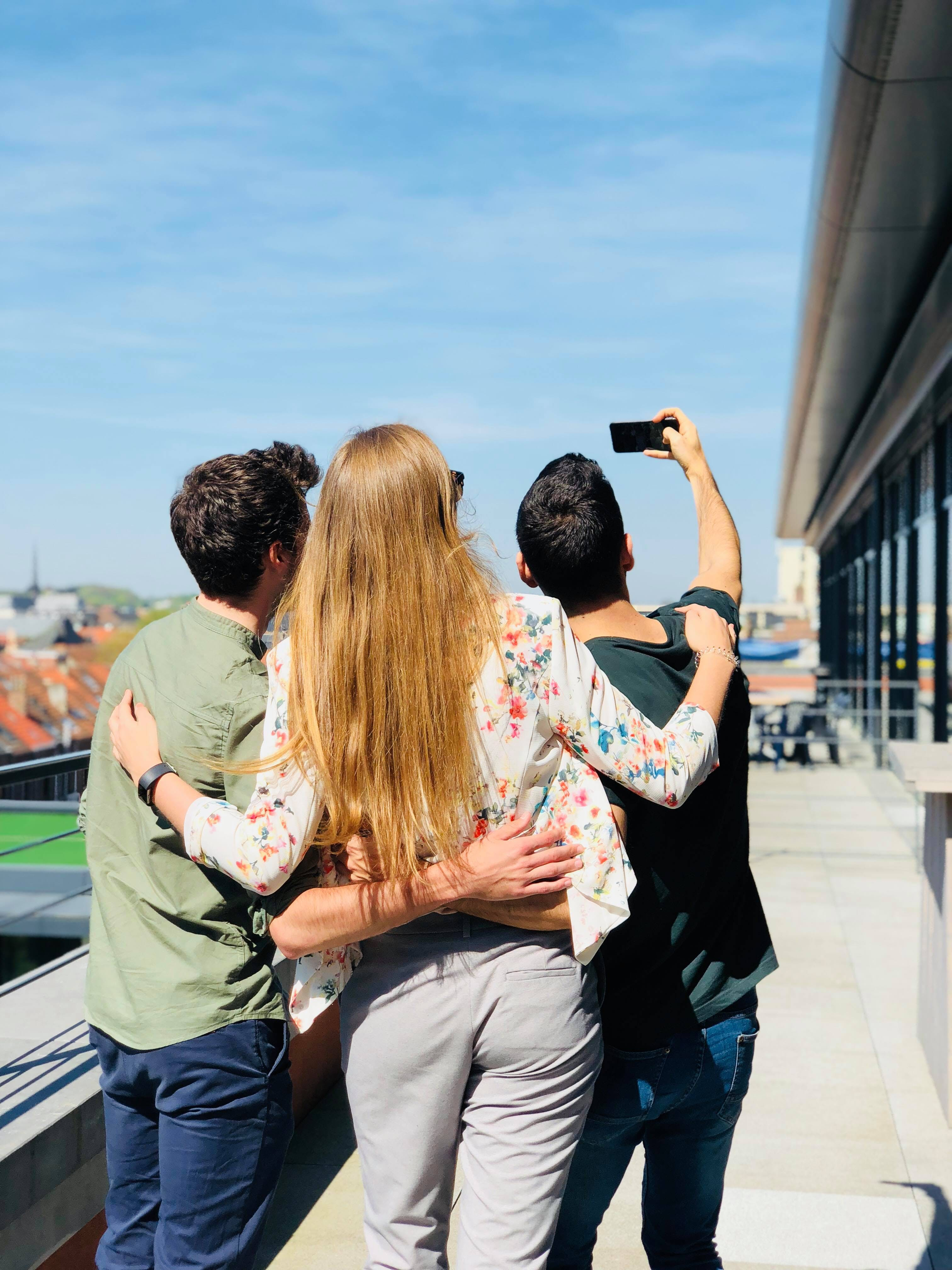 Three Person Doing Selfie Under Sunny Sky