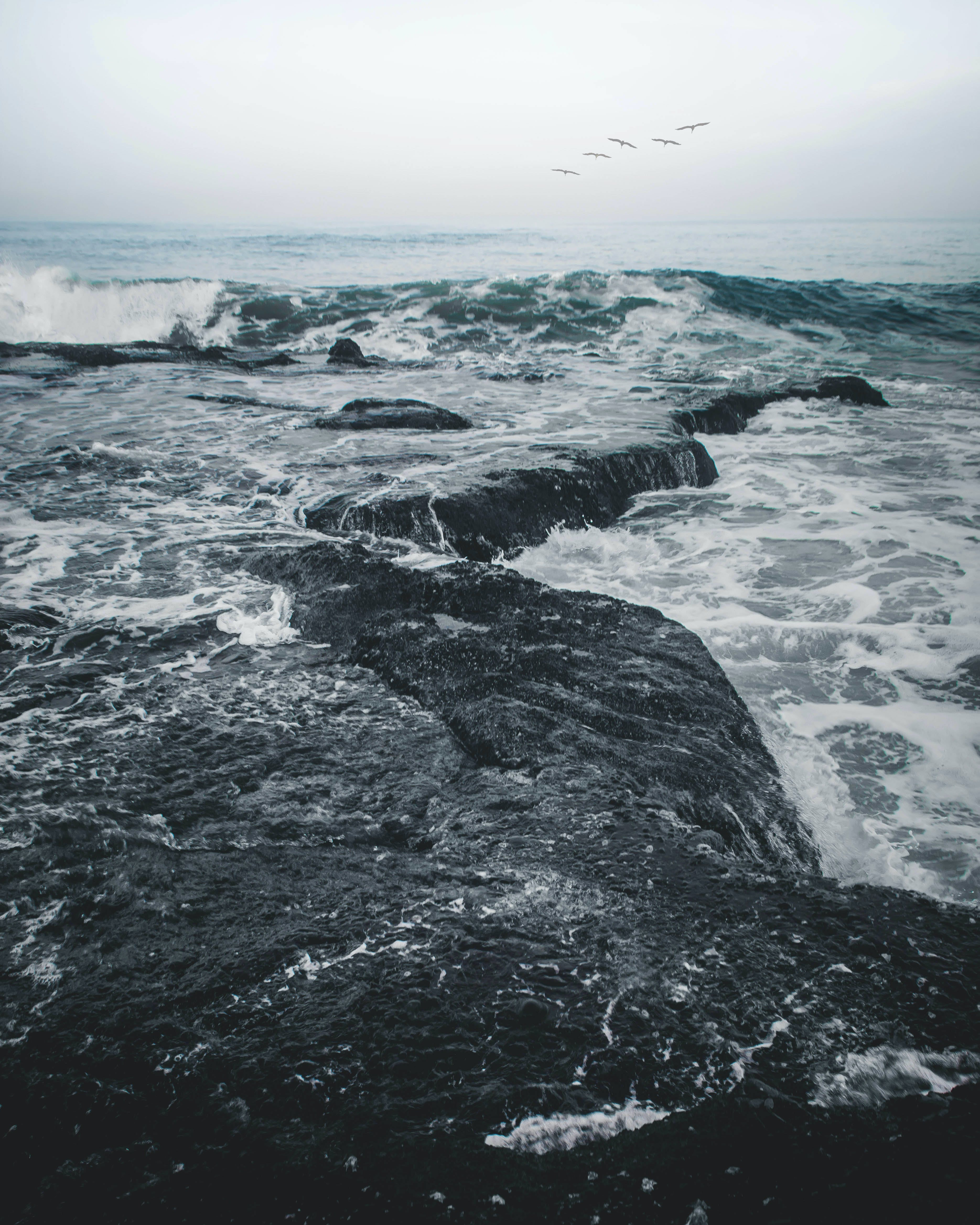 Landscape Photography of Body of Water Smashing in the Rocks