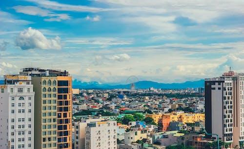 Gratis stockfoto met architectuur, attractie, bergen, binnenstad
