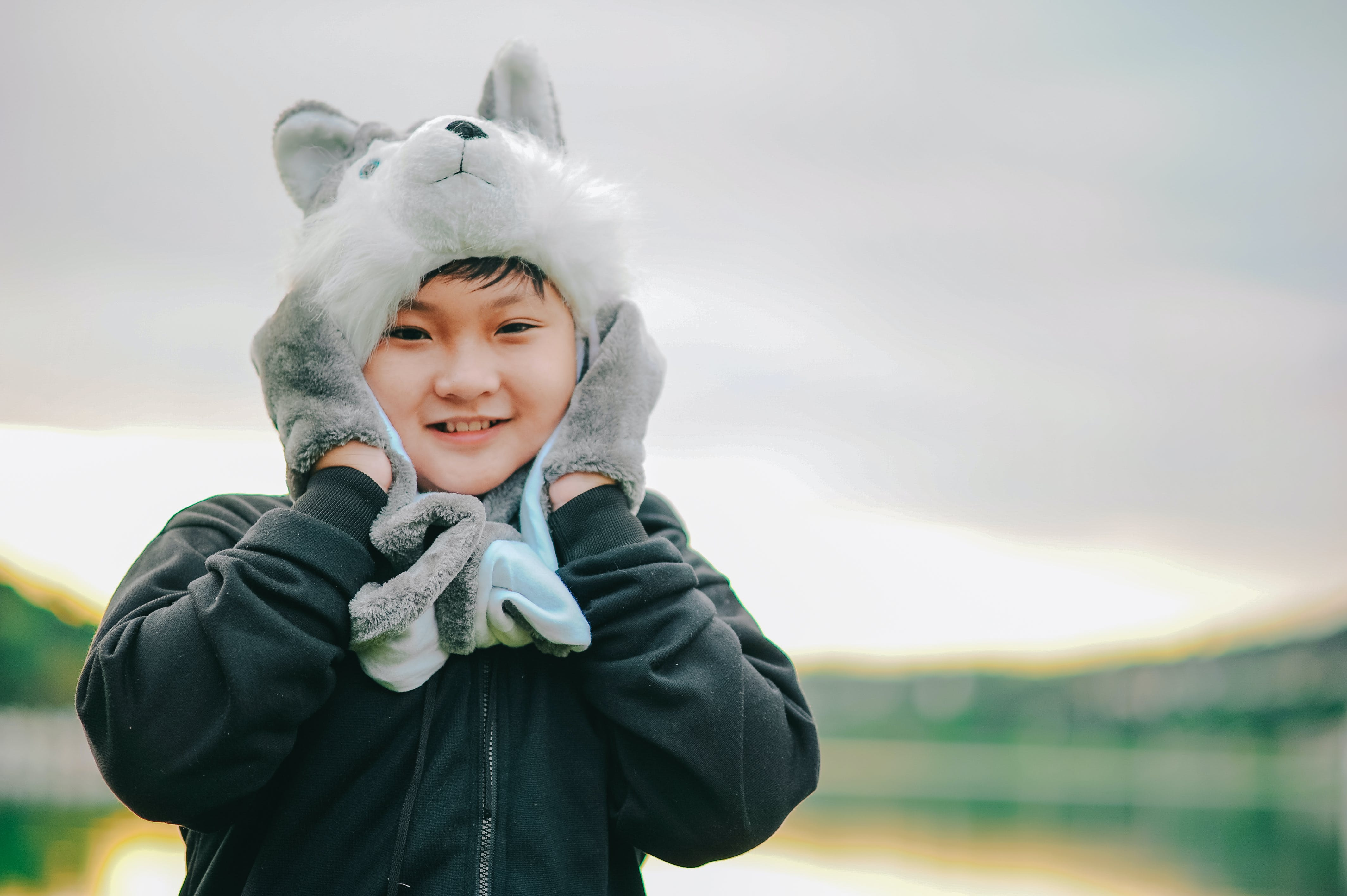 Boy Wearing Gray Dog Critter Hat
