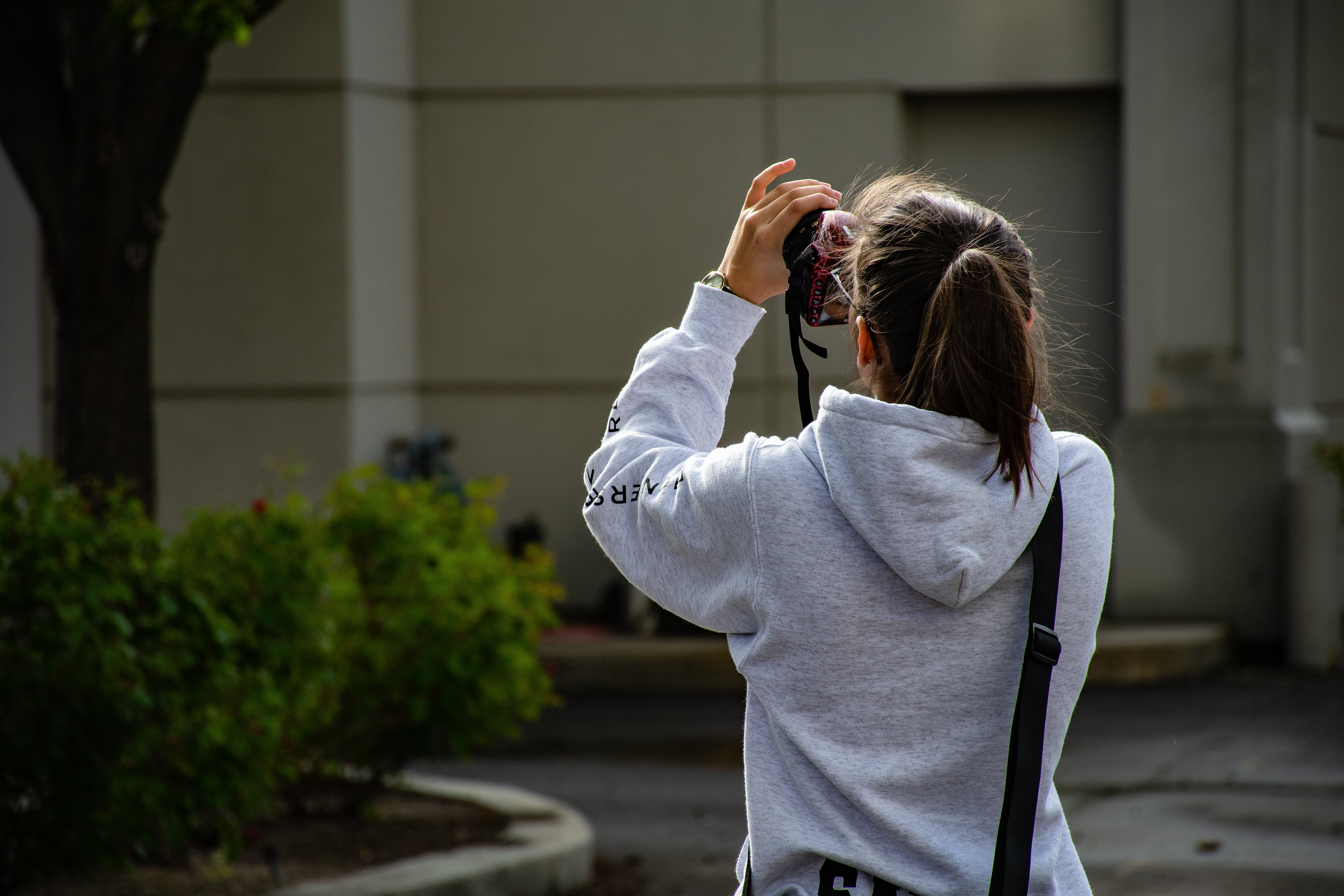 Photo of Girl Holding Dslr Camer and Taking Photo