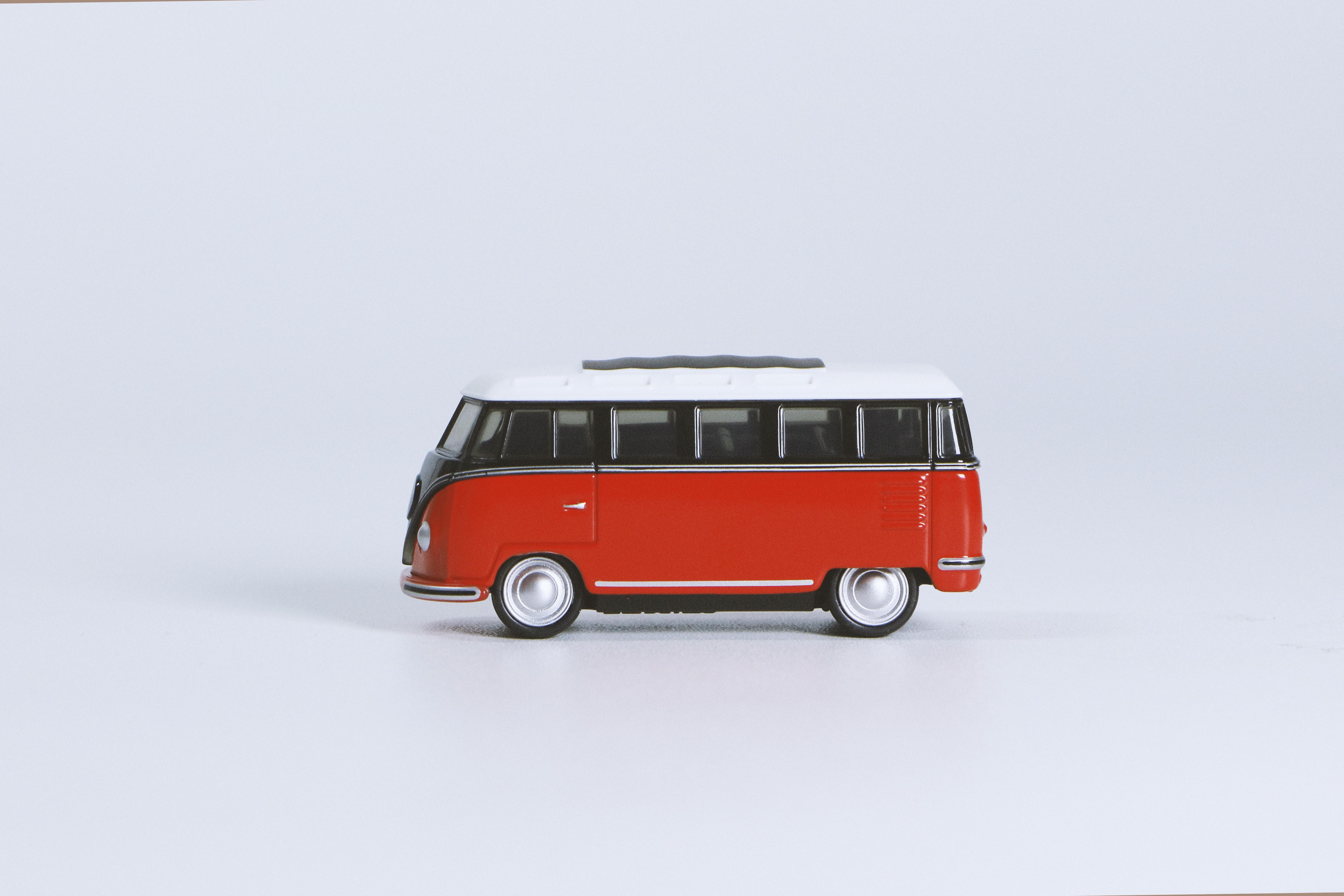Red Volkswagen T1 Die-cast Toy on White Surface