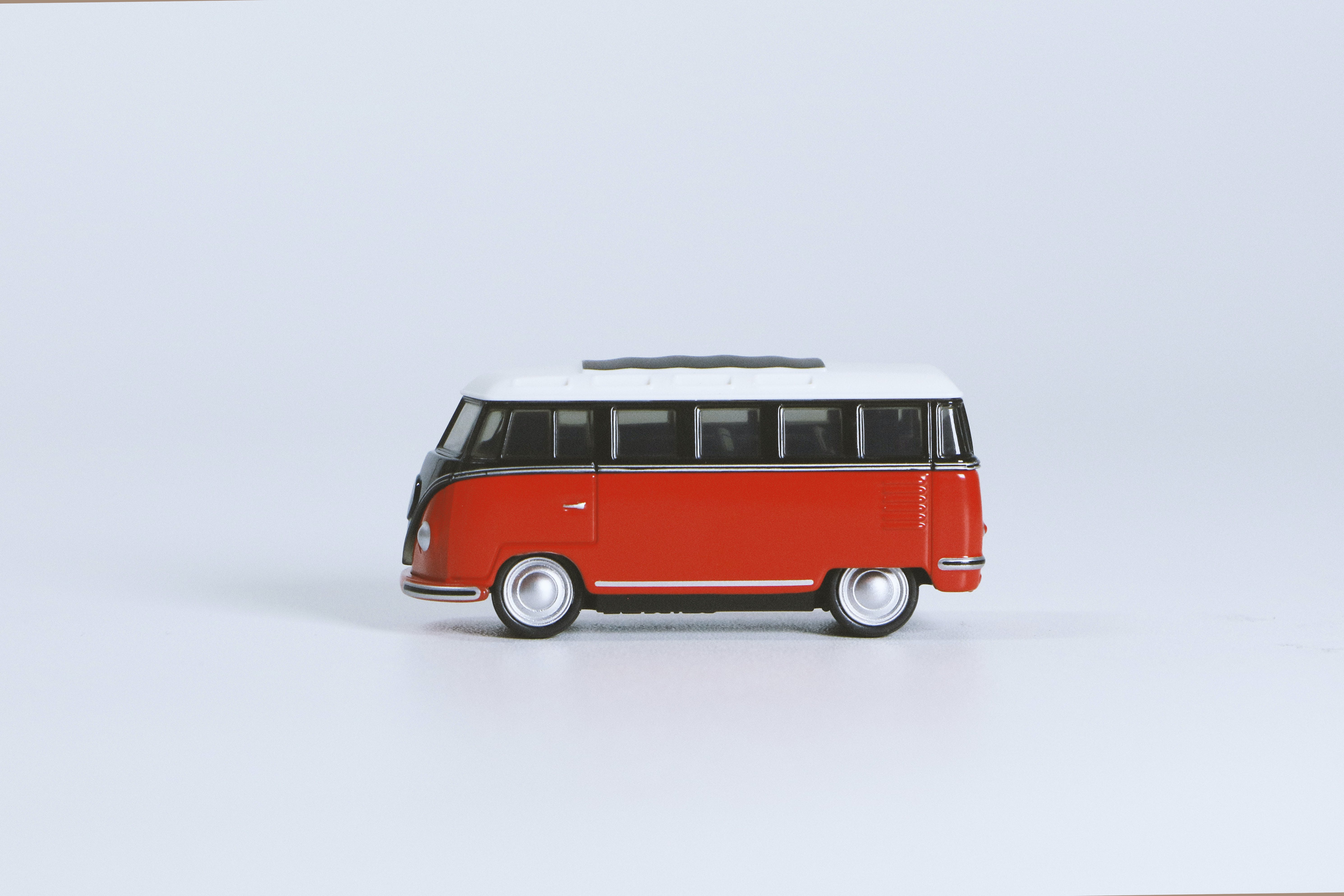 Red Volkswagen T1 Die-cast Toy on White Surface