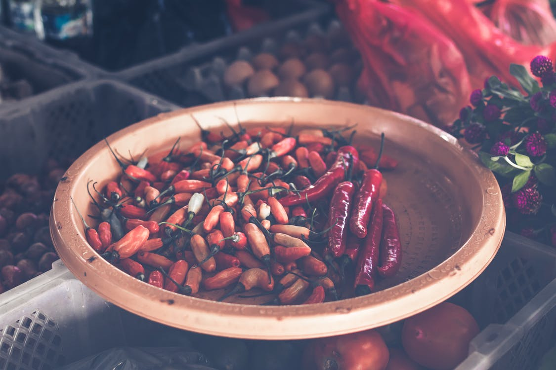 Red Chillis on Brown Wooden Tray