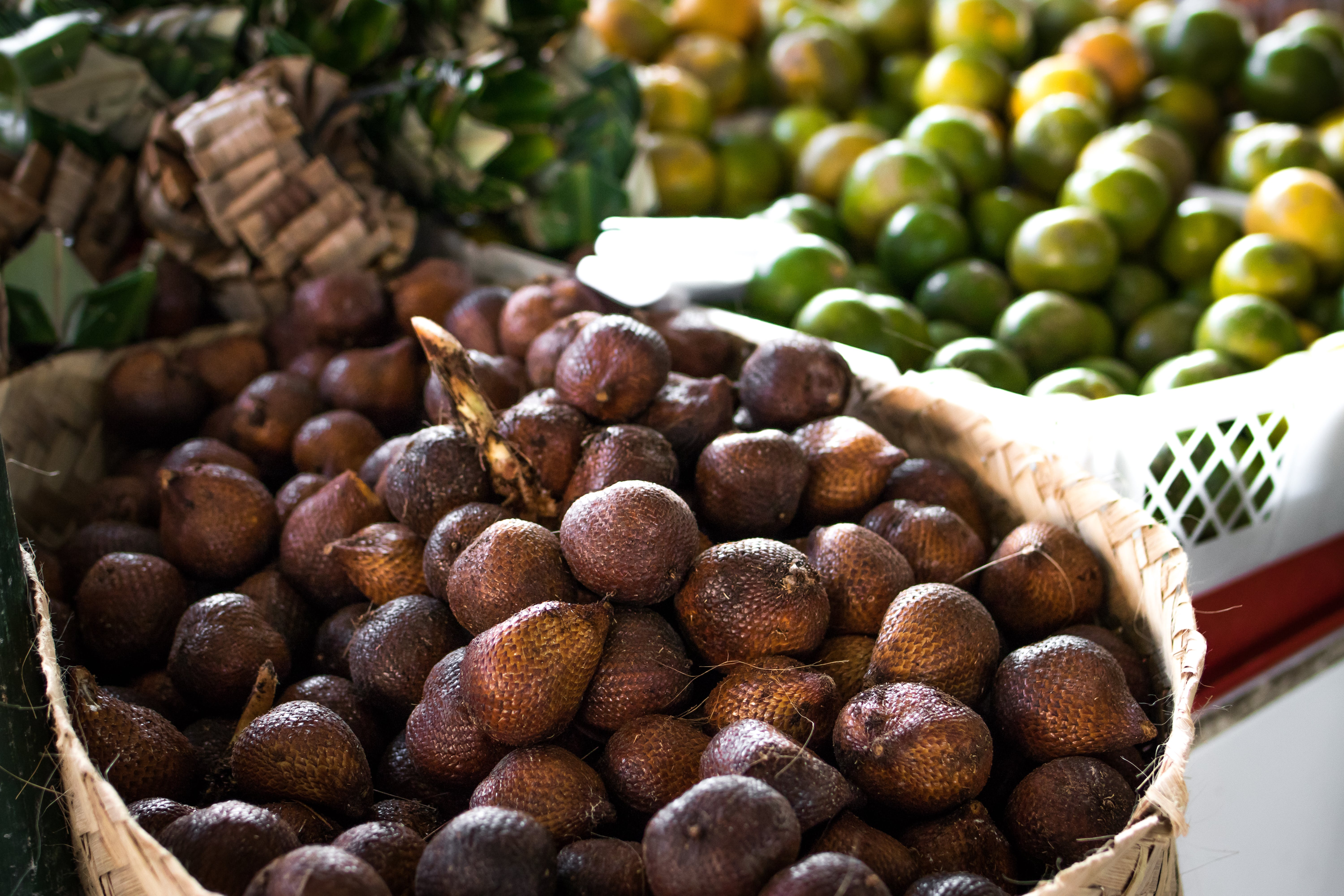 Pile of Brown Fruit With Brown Basket