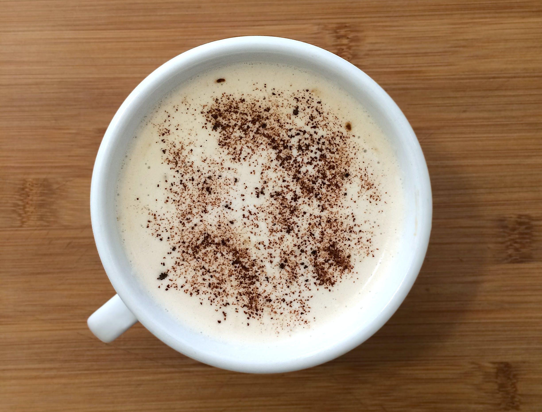 Food Photography of Brown Coffee Served on White Ceramic Mug