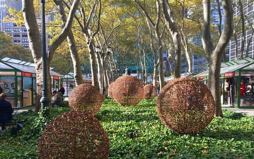 Brown Wicker Ball Light Decors Under Tall Trees