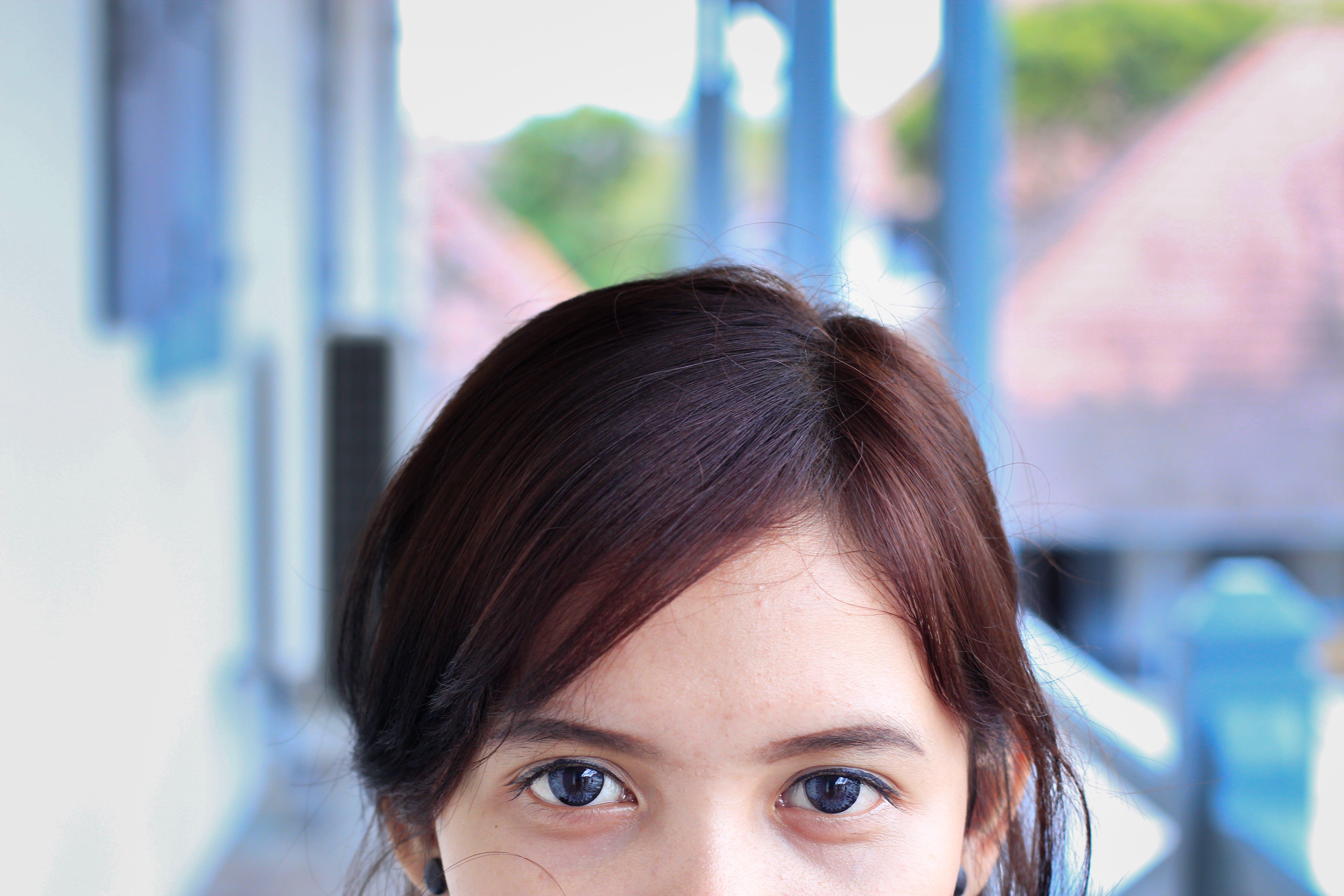 Gratis lagerfoto af ansigtsudtryk, close-up, dagslys, hår