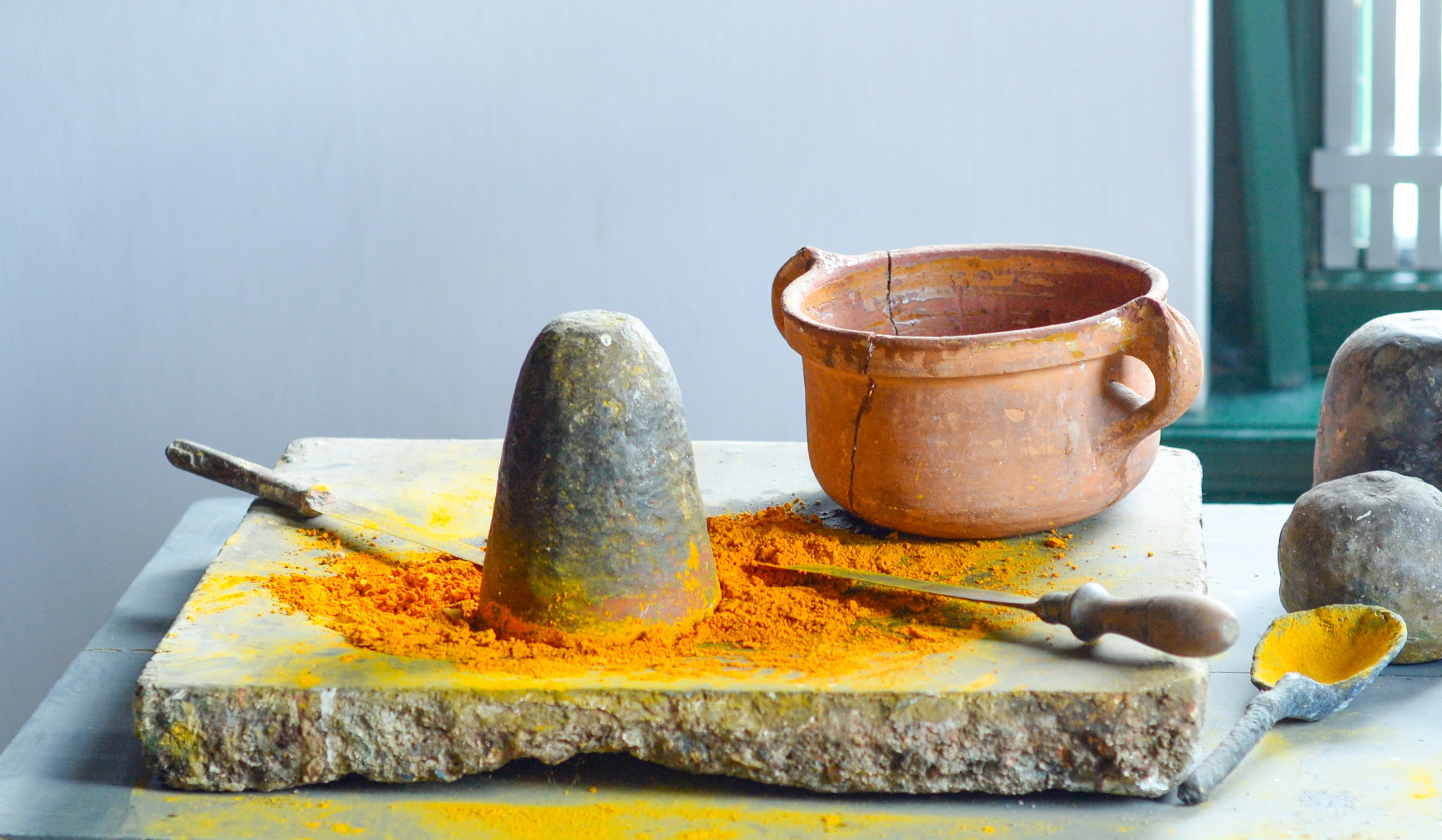 Brown Clay Pot on Gray Surface