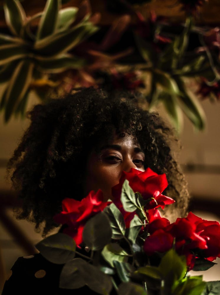 Woman Behind Red Flowers