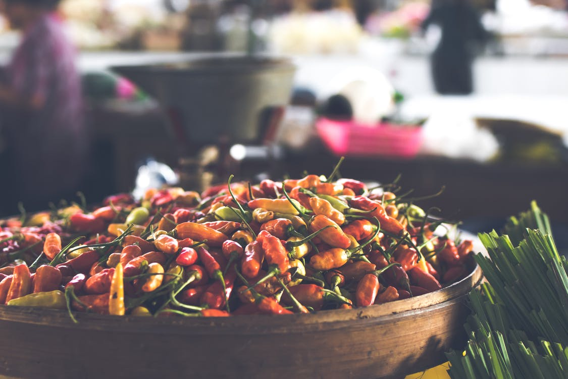 Focus Photo of Round Brown Wooden Bowl Filled With Chili Lot