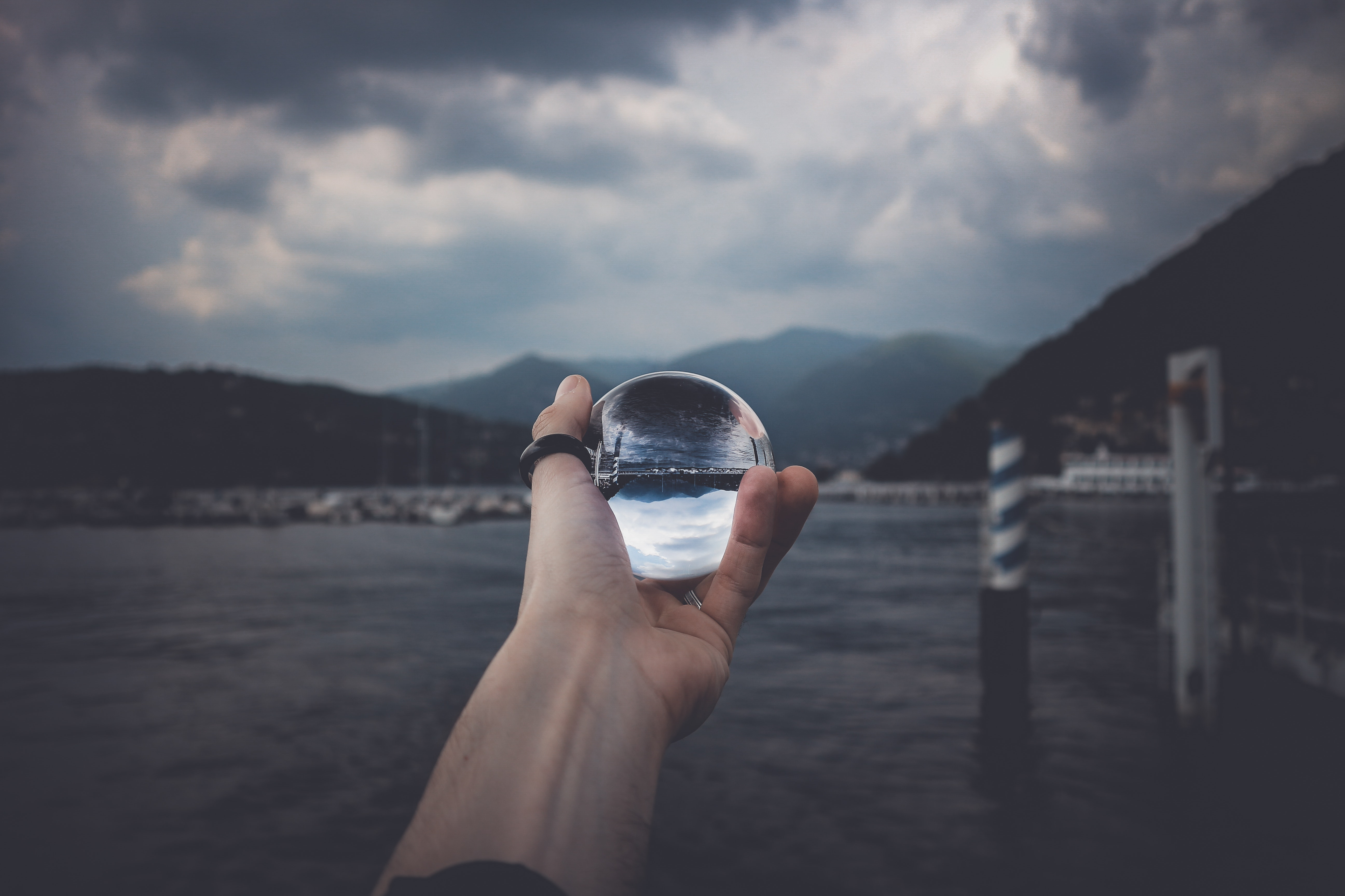 photo displays person holding ball with reflection of