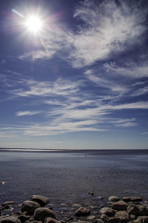 Photos gratuites de bord de mer, brillant, cailloux, ciel