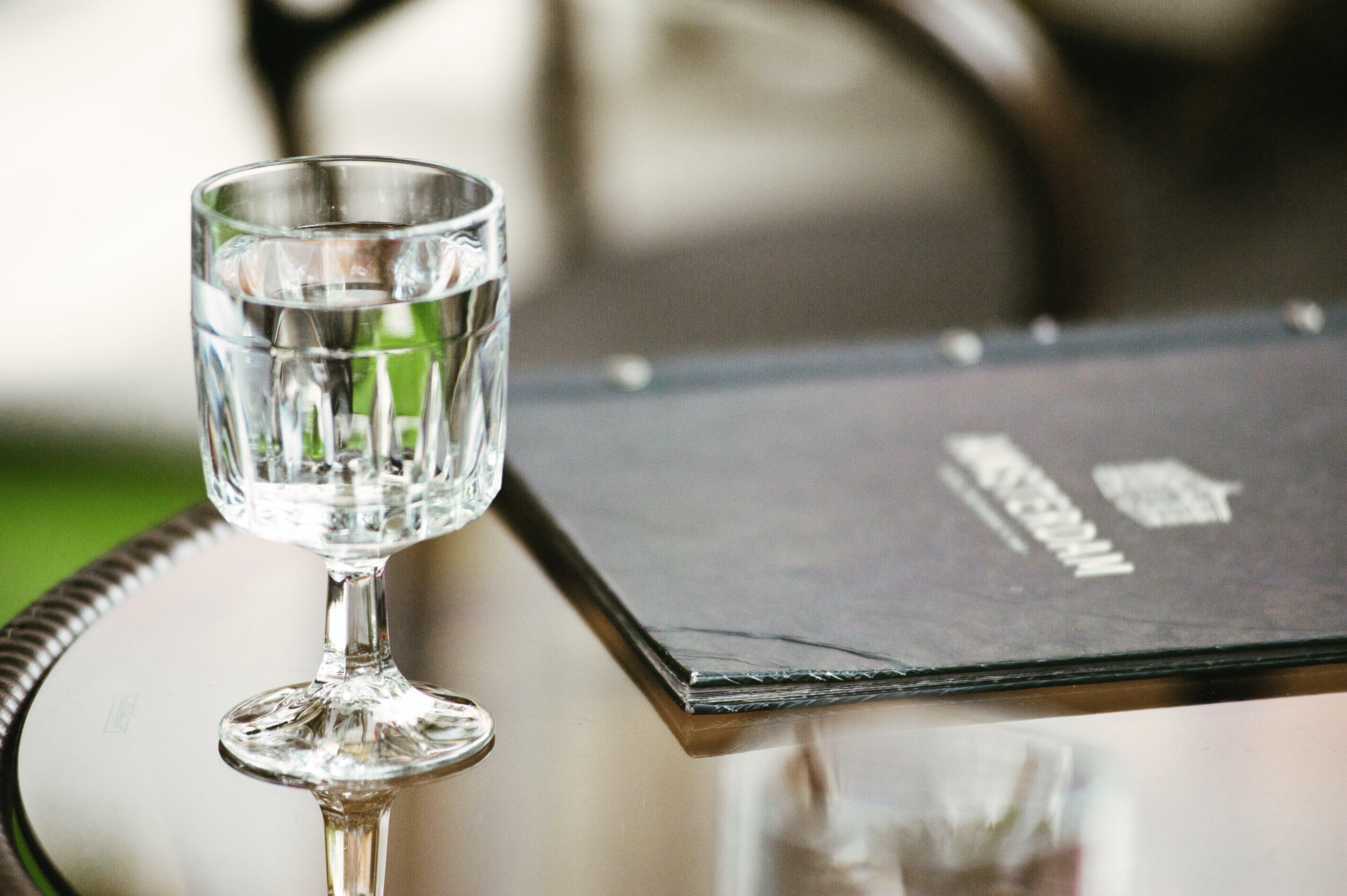 Clear Short-stemmed Glass Beside Menu
