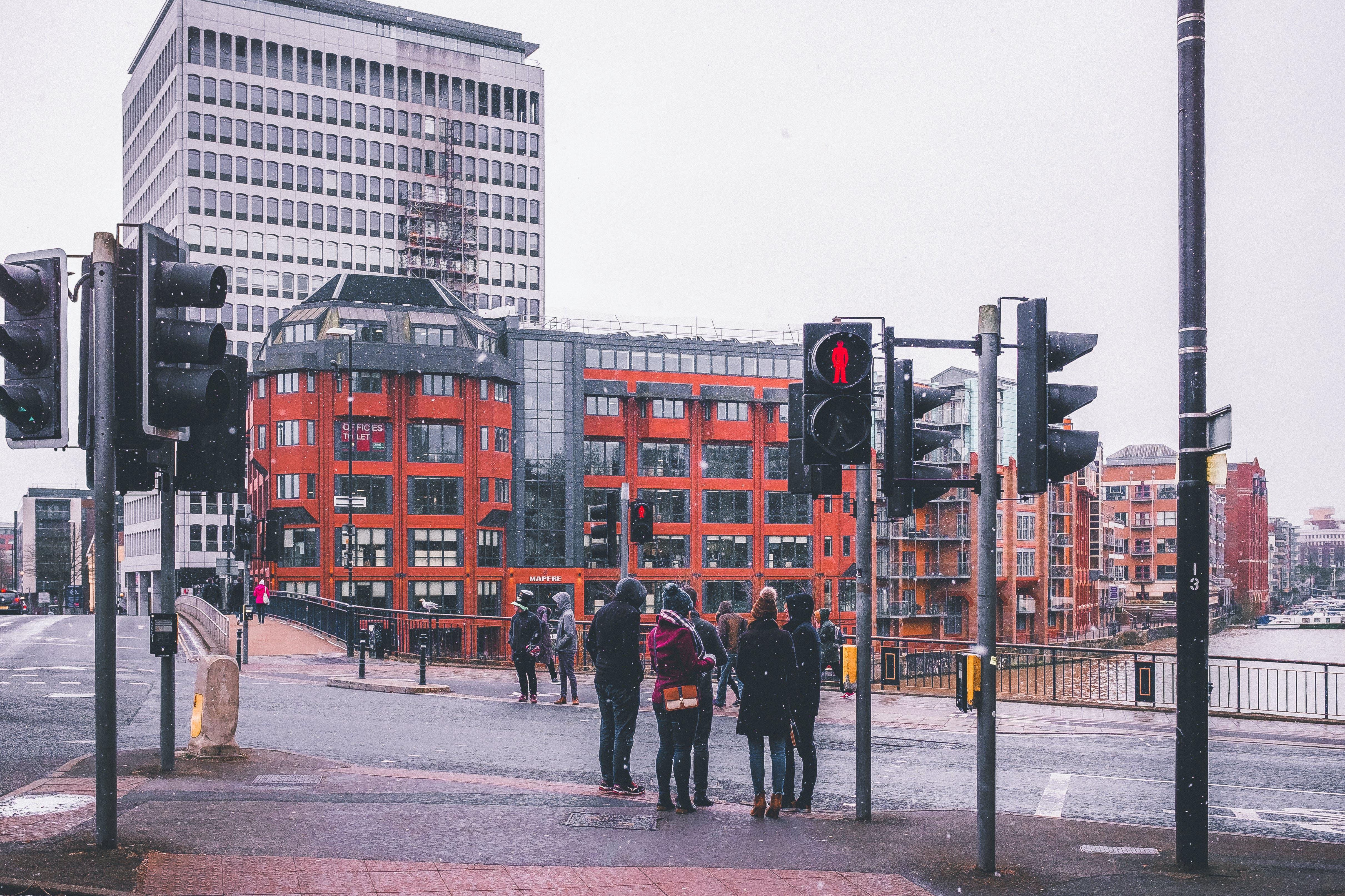 Portrait Photography of People Near Street Light