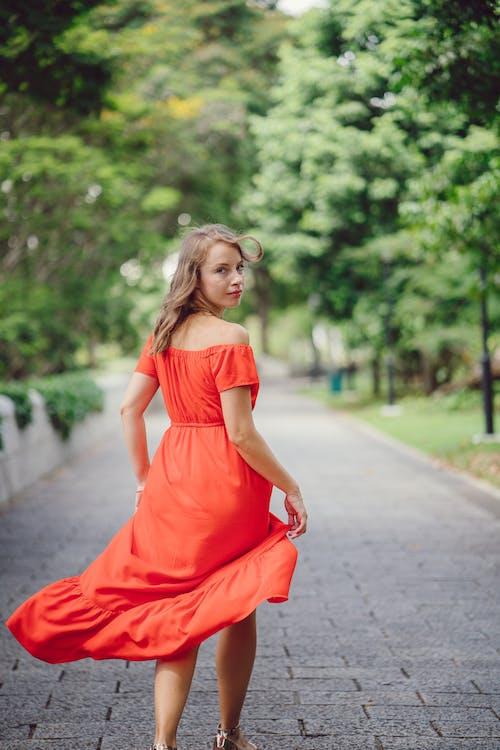 Woman Wearing Orange Off-shoulder Dress