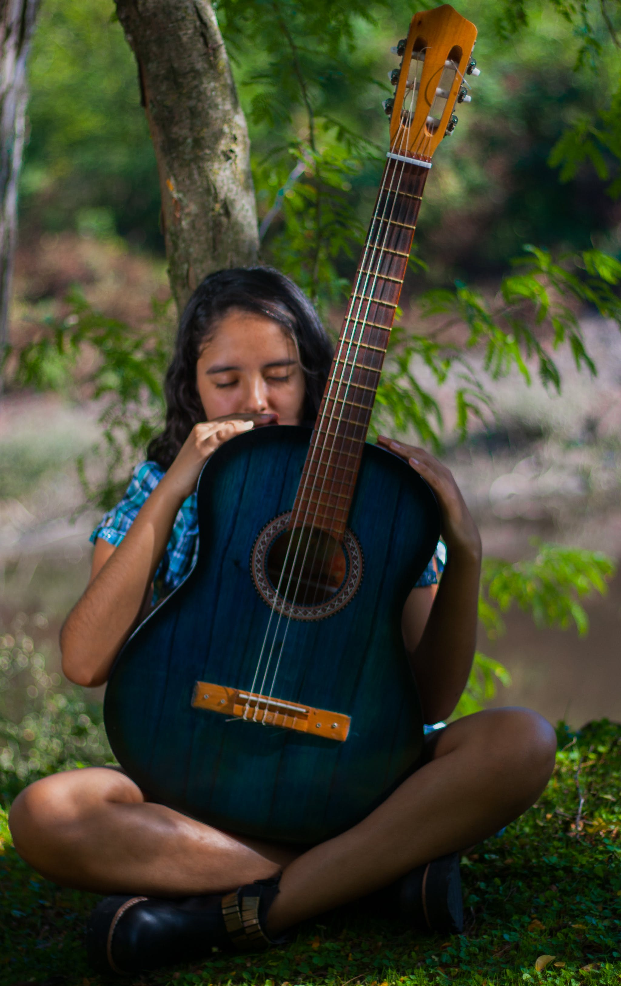Woman Holding Blue Classical Guitar