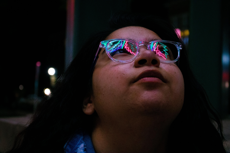 Woman Wearing Eyeglasses during Nighttime