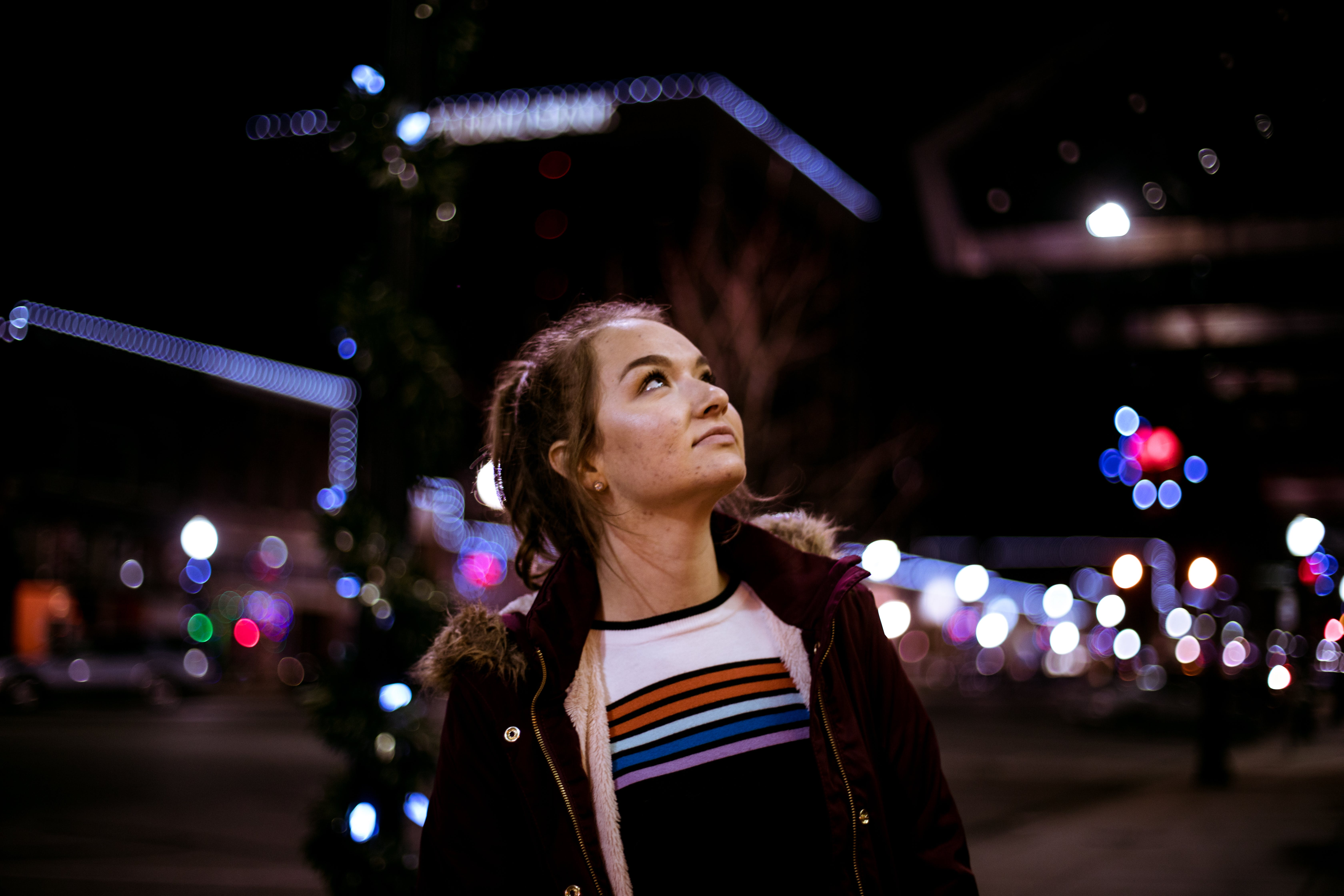 Woman Looking Up during Night Time
