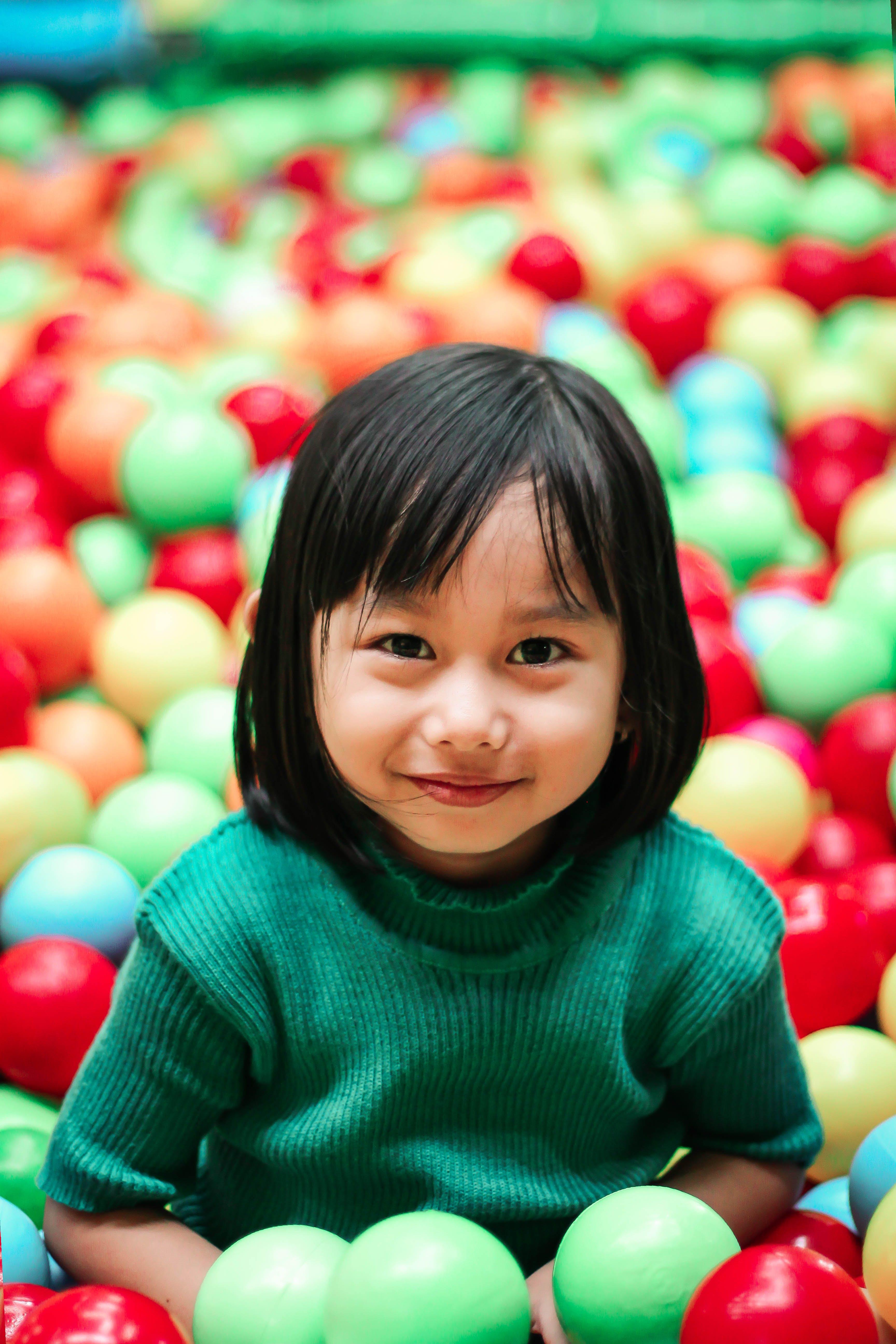 Girl Wearing Green Knit Shirt