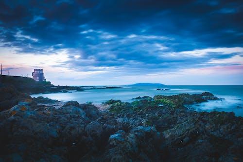 Lighthouse on Cliff Near Sea