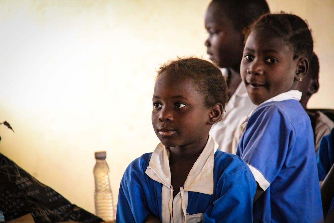 Three Children Wearing School Uniforms