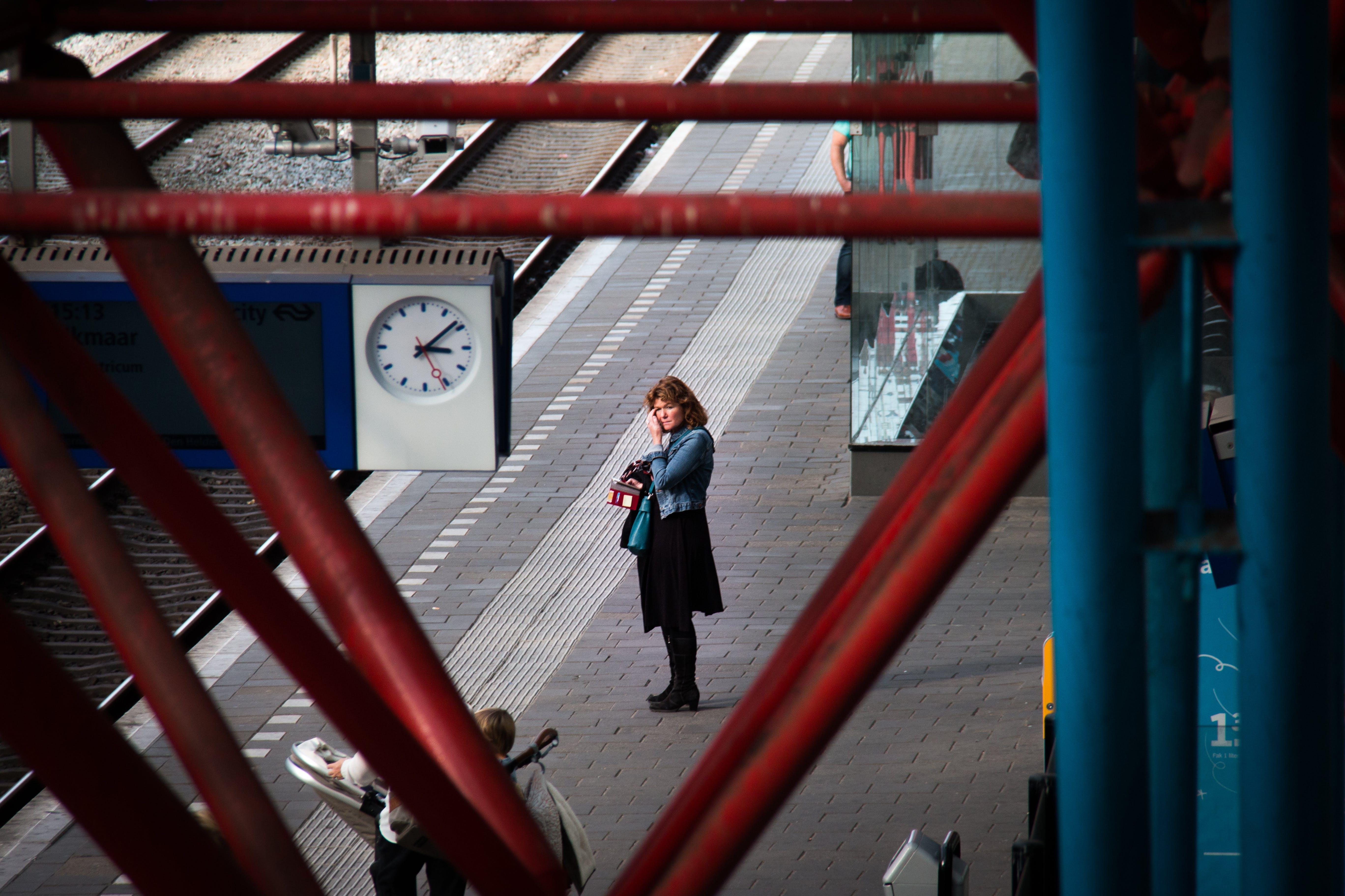 Woman Standing Near Rail Road