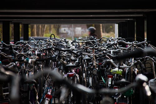 Tilt Shift Lens Photography of Gray and Black Bicycle Lot