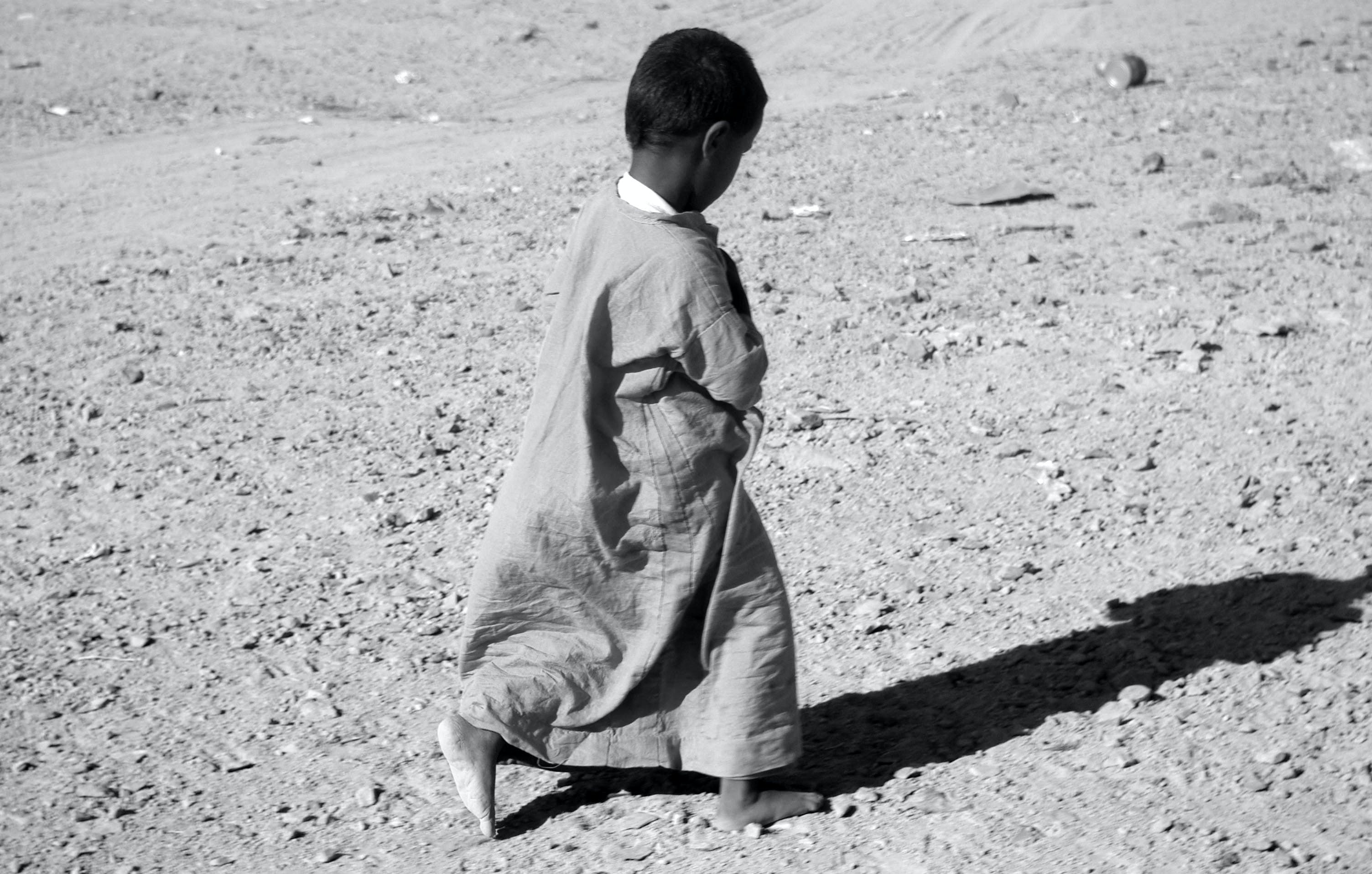 Photographed Grayscale of Child in Dress