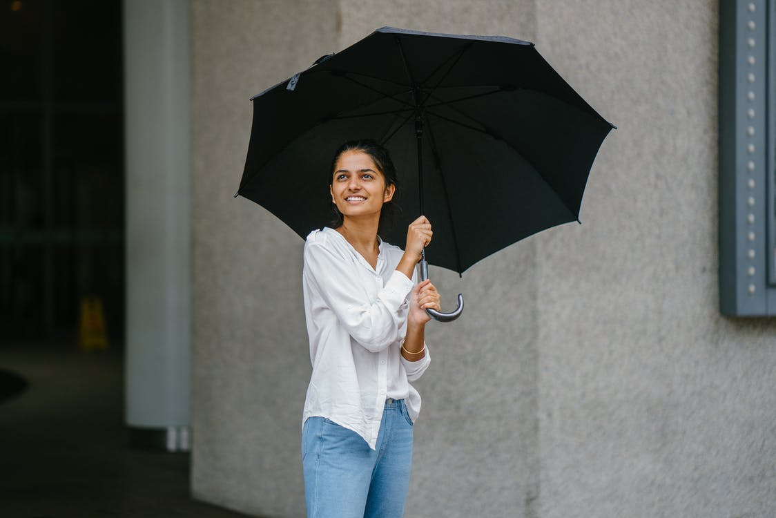 Woman in White Button-up Long-sleeved Shirt Holding Black Umbrella