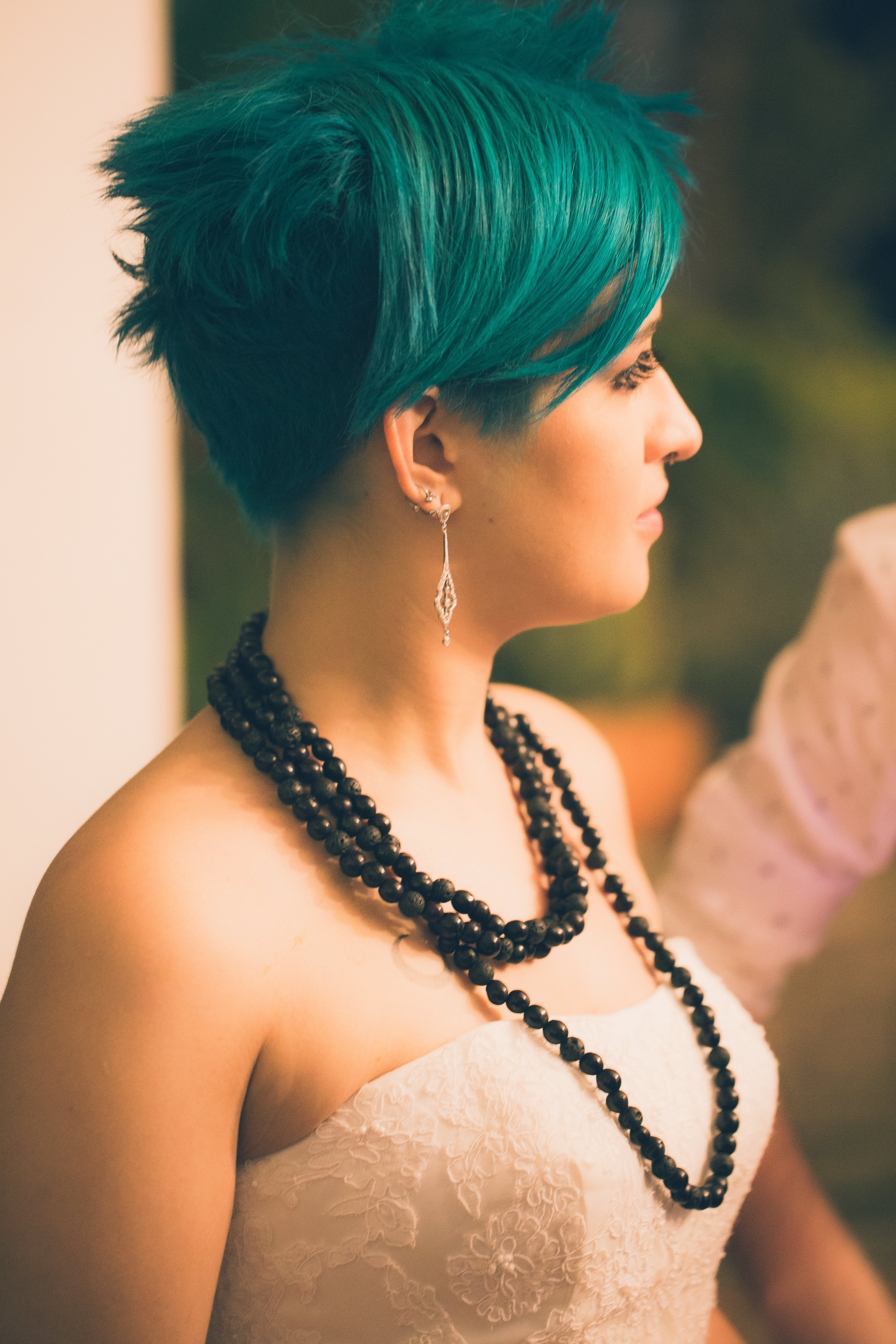 Tilt Shift Lens Photography of Woman Wearing Beaded Black Necklace