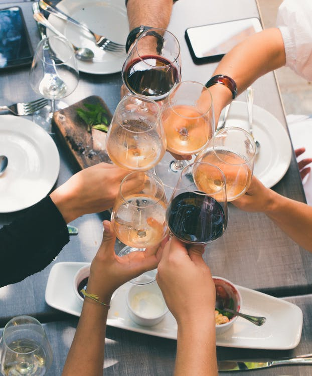 Group of People Holding Wine Glasses
