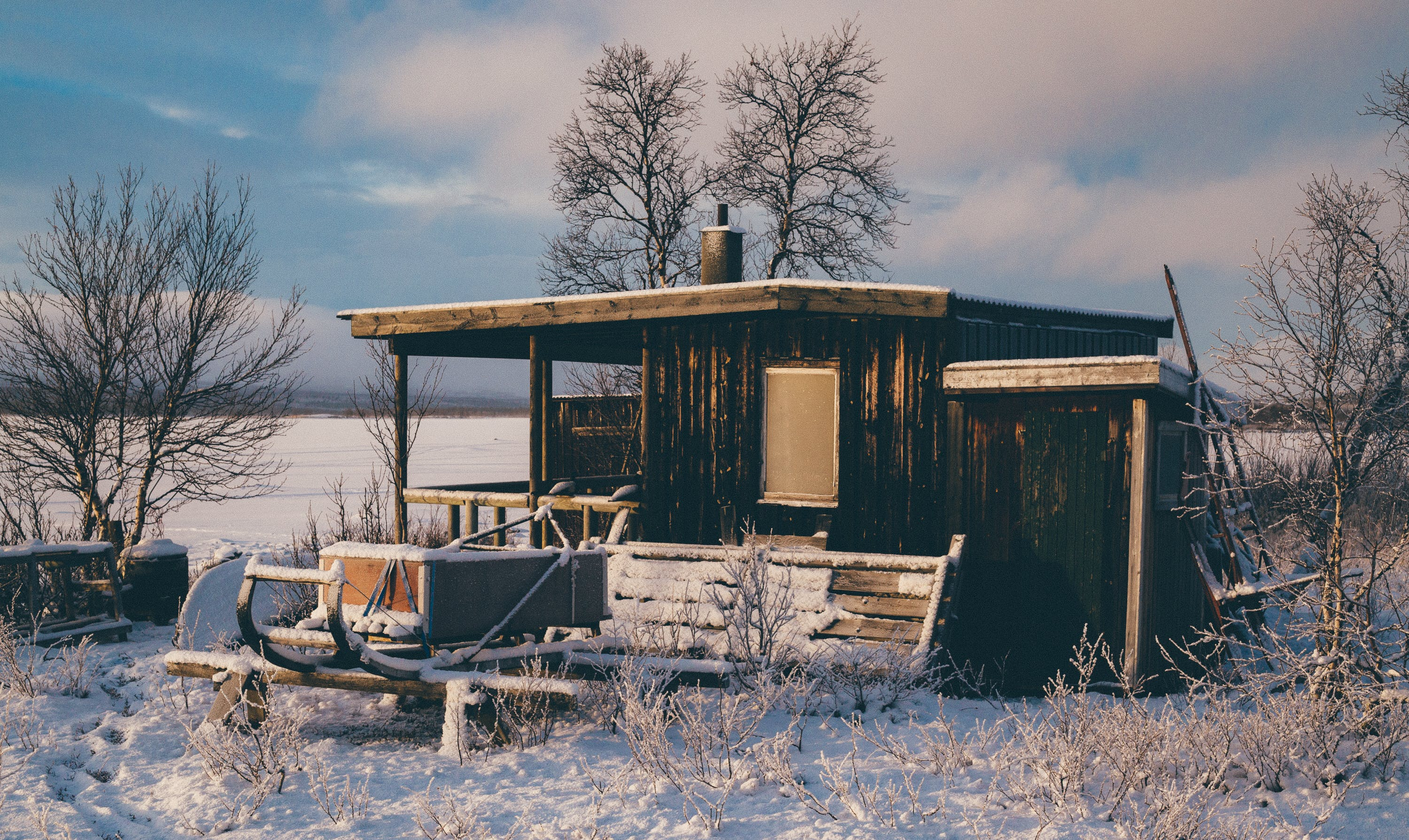Brown Wooden Barn Surrounded by Snow