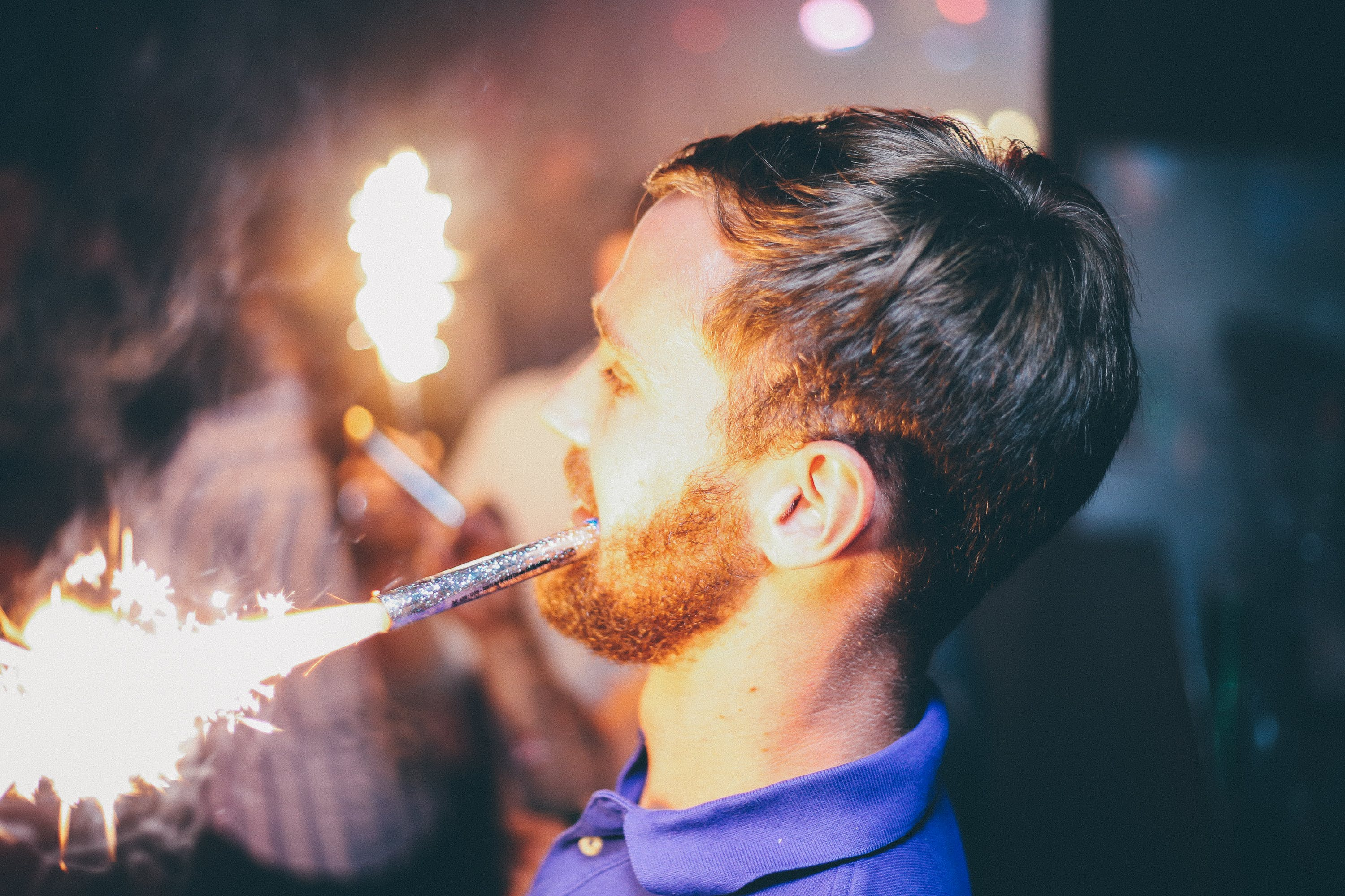 Person Holding Fireworks by Mouth