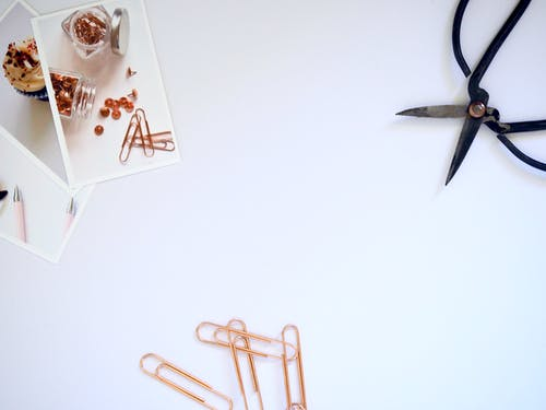 Flat Lay Photography of Paper Clips and Scissor