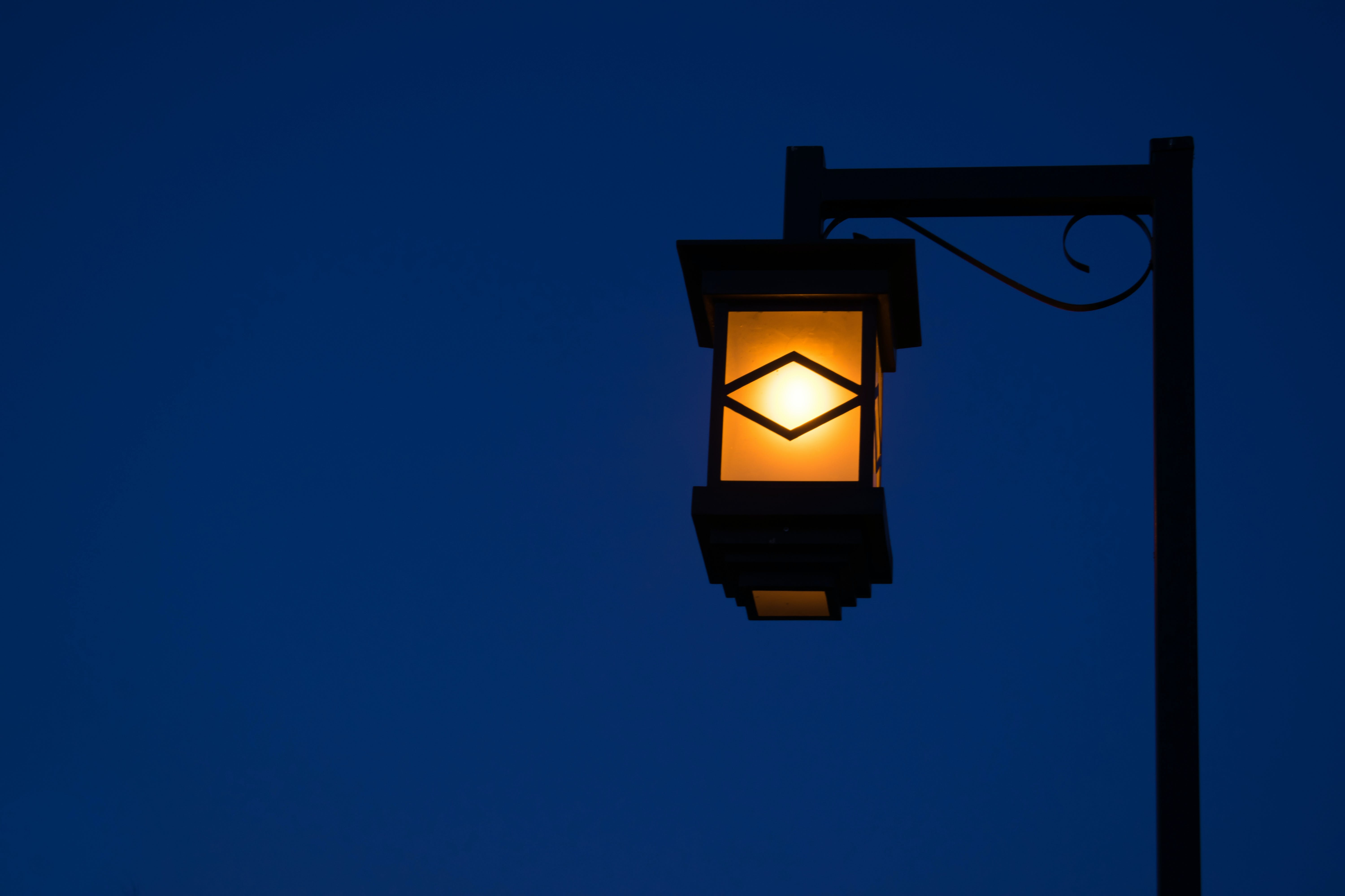 Black Street Lamp Turned on during Night