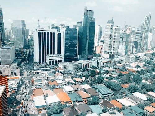 Gratis lagerfoto af arkitektur, biler, by, bygninger