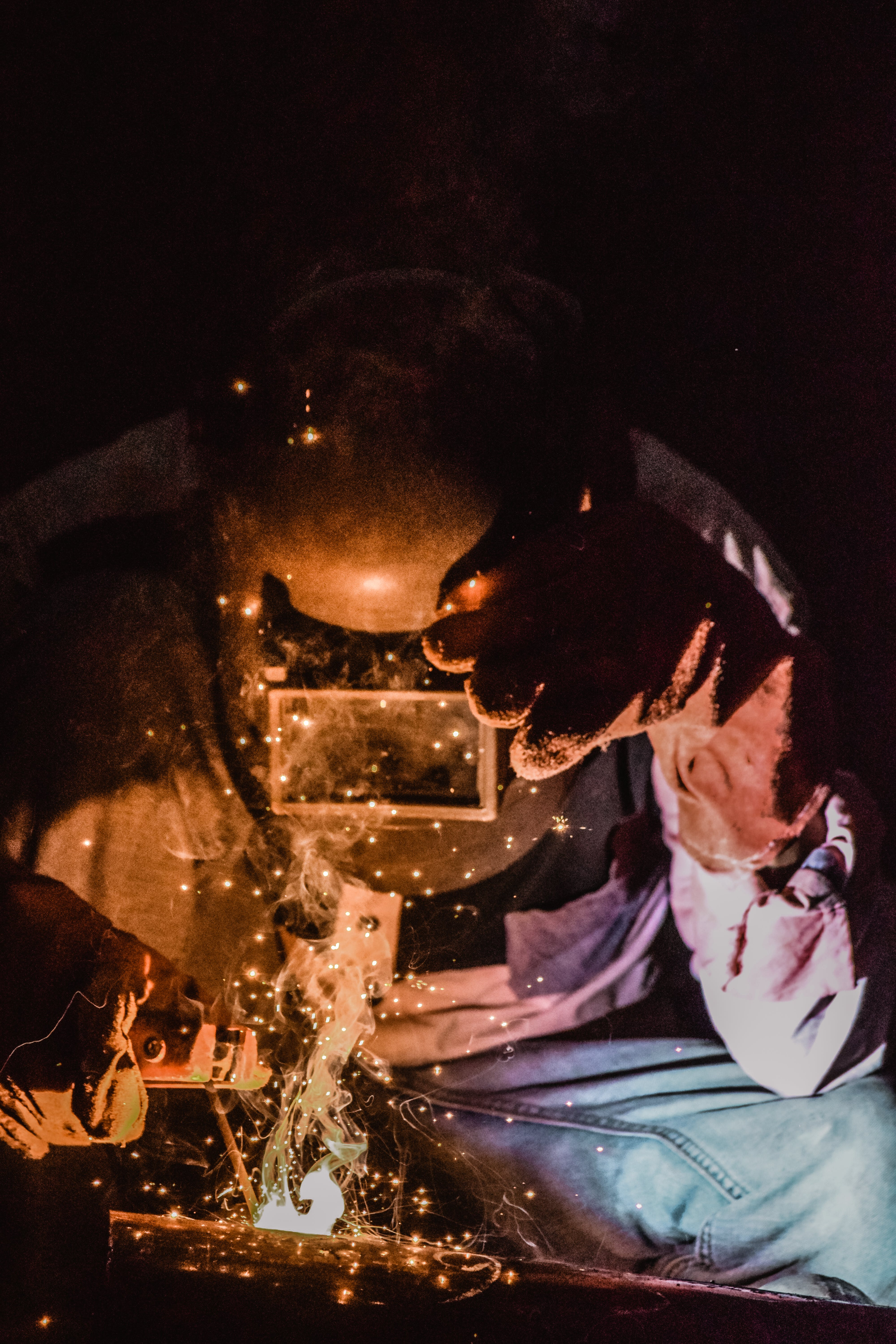 Photography of a Person Wearing Welding Mask