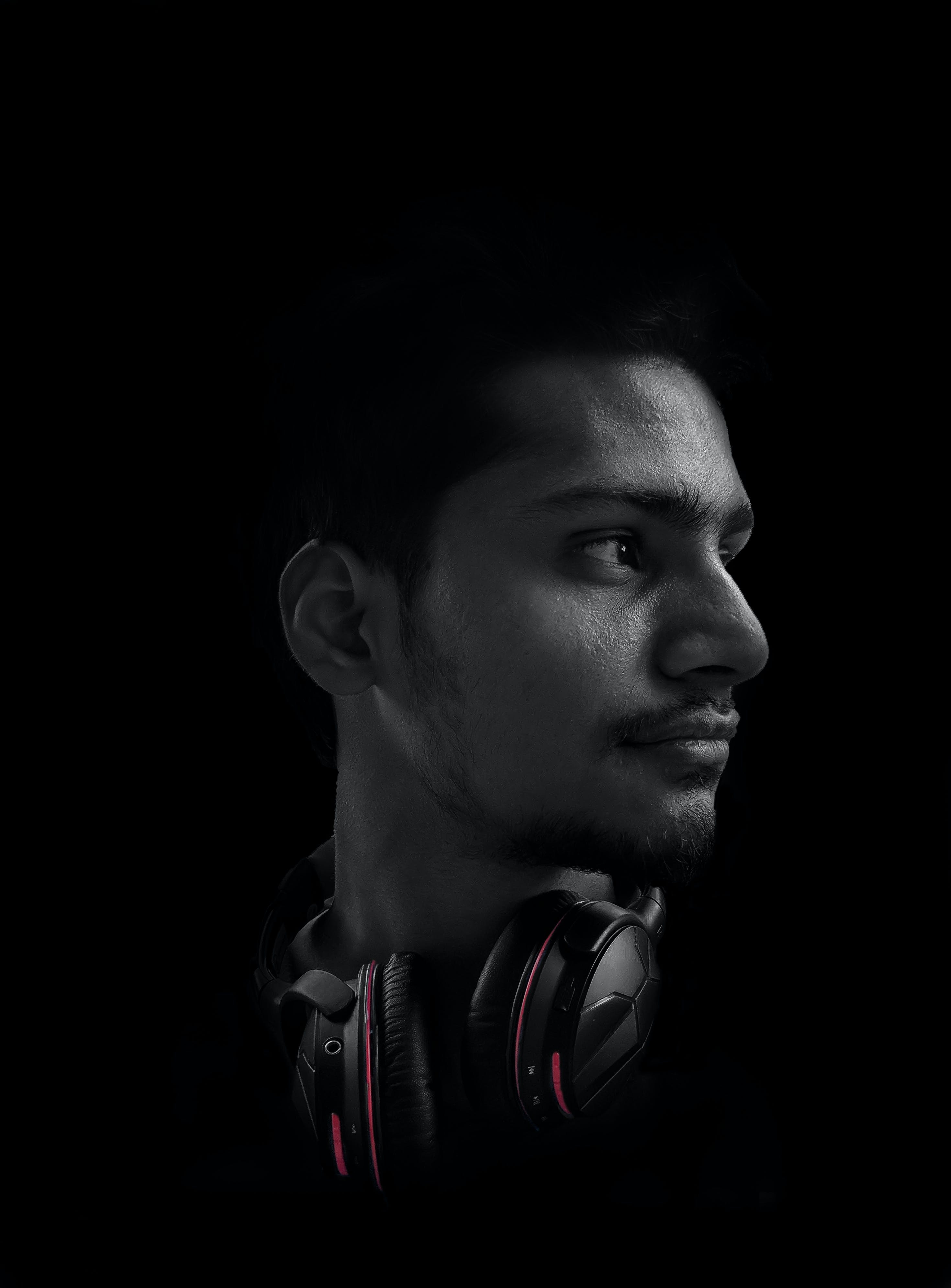 Photo of Man Wearing Black and Red Headphones