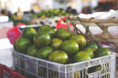 Crate of Round Green Fruits