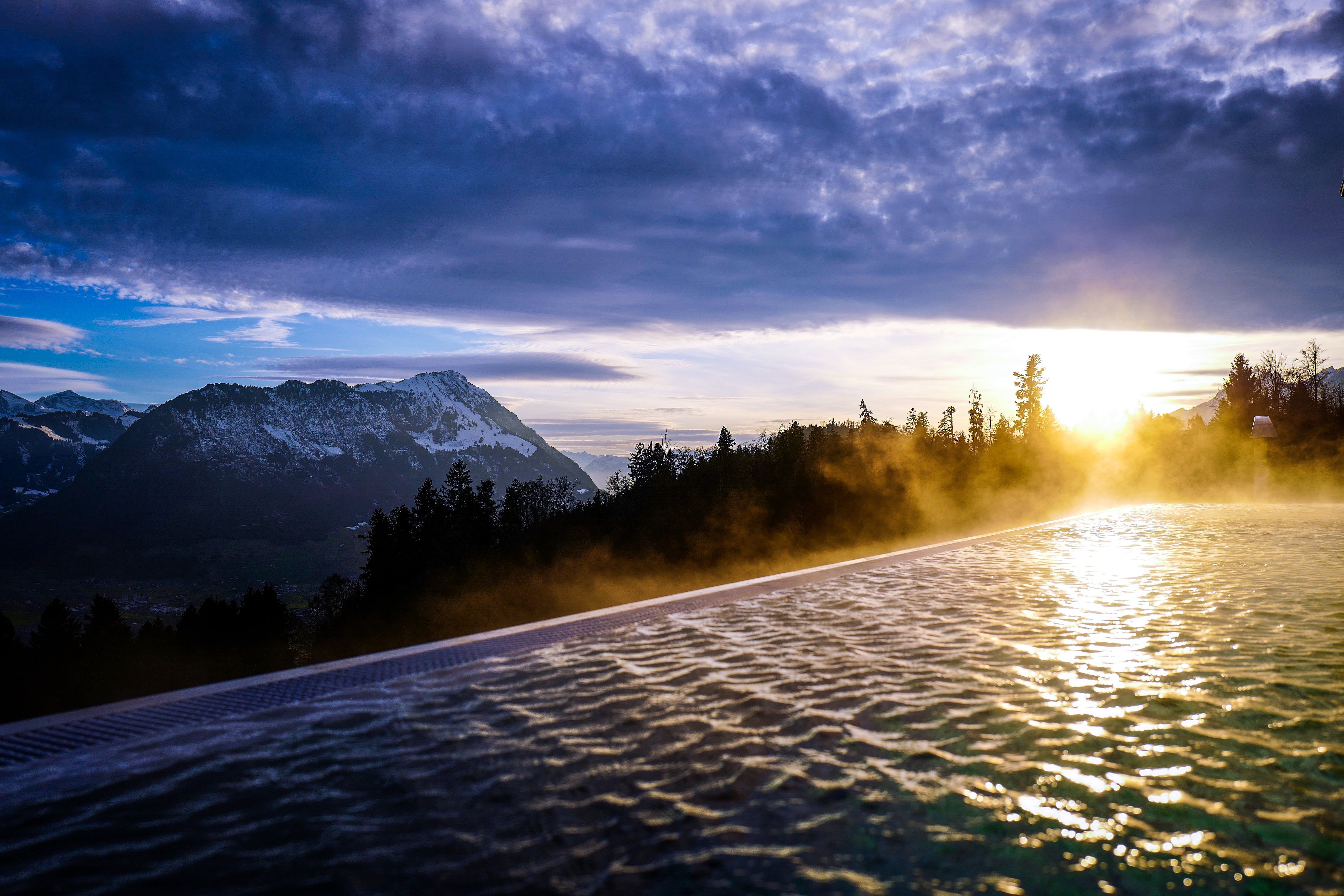 Infinity Pool Near the Forest during Golden Hour