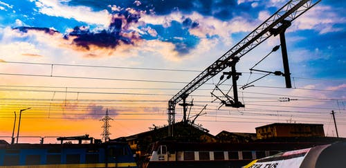 Blue and Yellow Train Photography during Nightfall