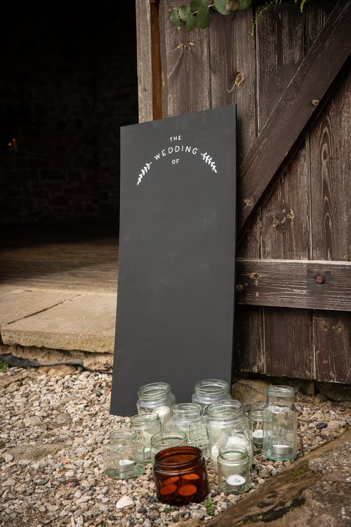 Clear Glass Jars Near Black Board