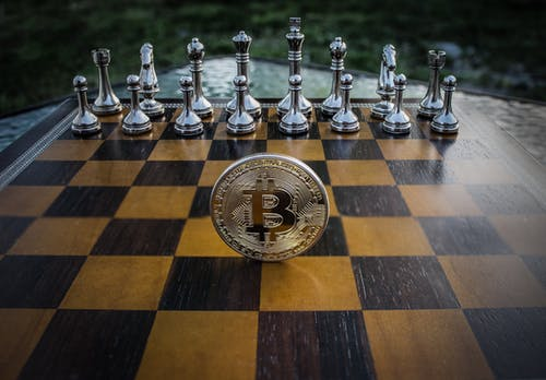 Close-up Photography of Coin on Chessboard